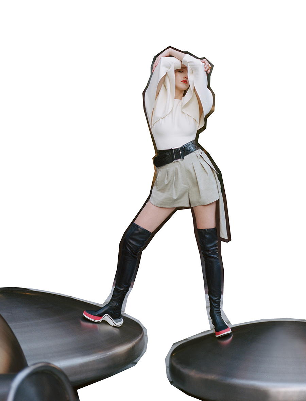 Top, shorts, boots:  Louis Vuitton /  Belt: Stylist's own / Ring:  Louise Olsen
