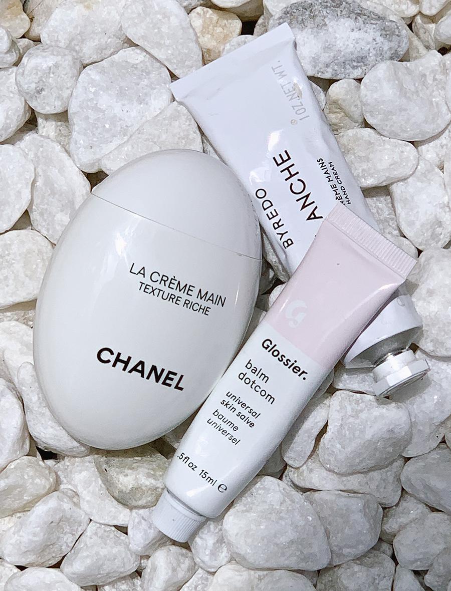 Clockwise from left:    Chanel  | LA CRÈME MAIN Texture Riche  - £45.00    BYREDO  | Blanche hand cream  - £29.00    Glossier  | Balm dotcom  - £10.00