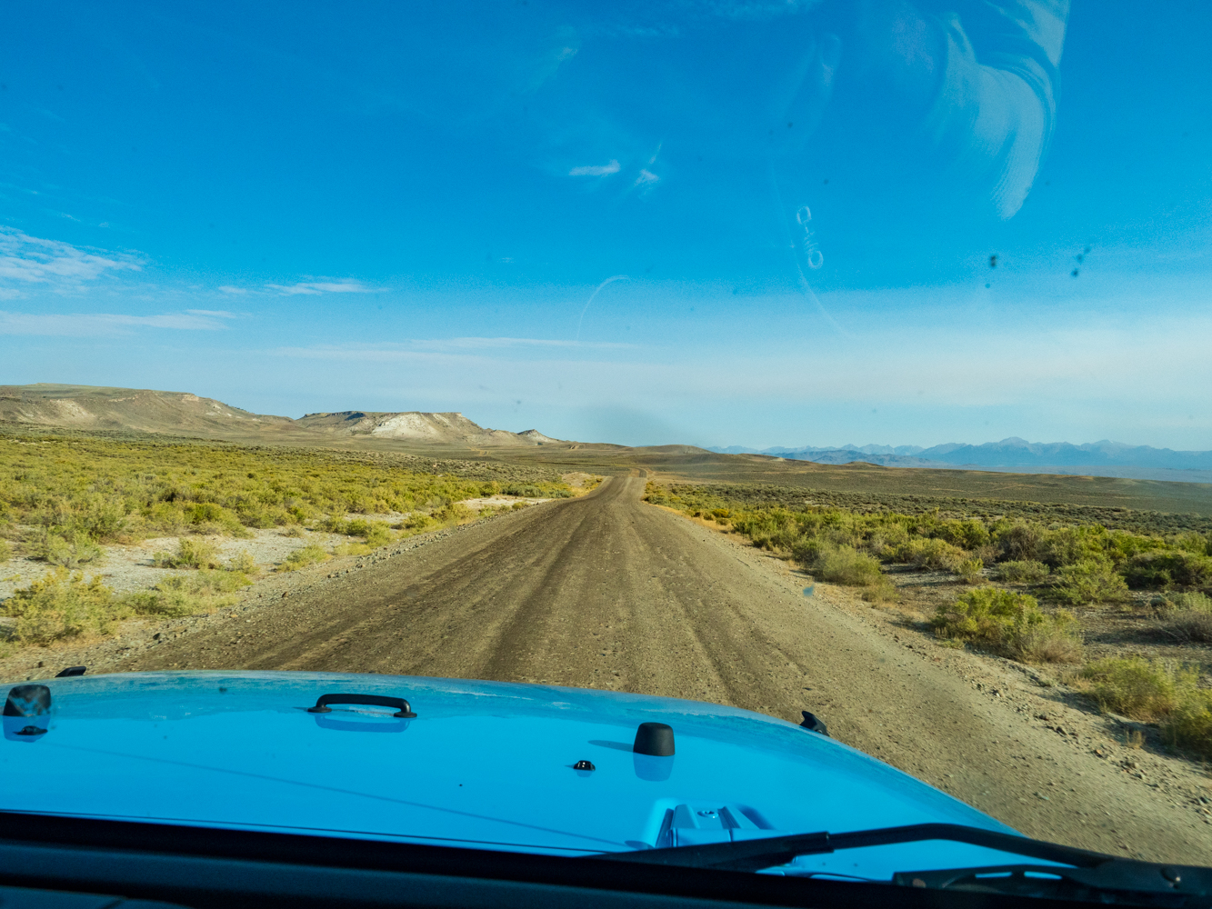 The last 40 miles are all dirt road. We got lucky and were able to rent a brand new Jeep Wrangler! The winds are the mountains in the distance.