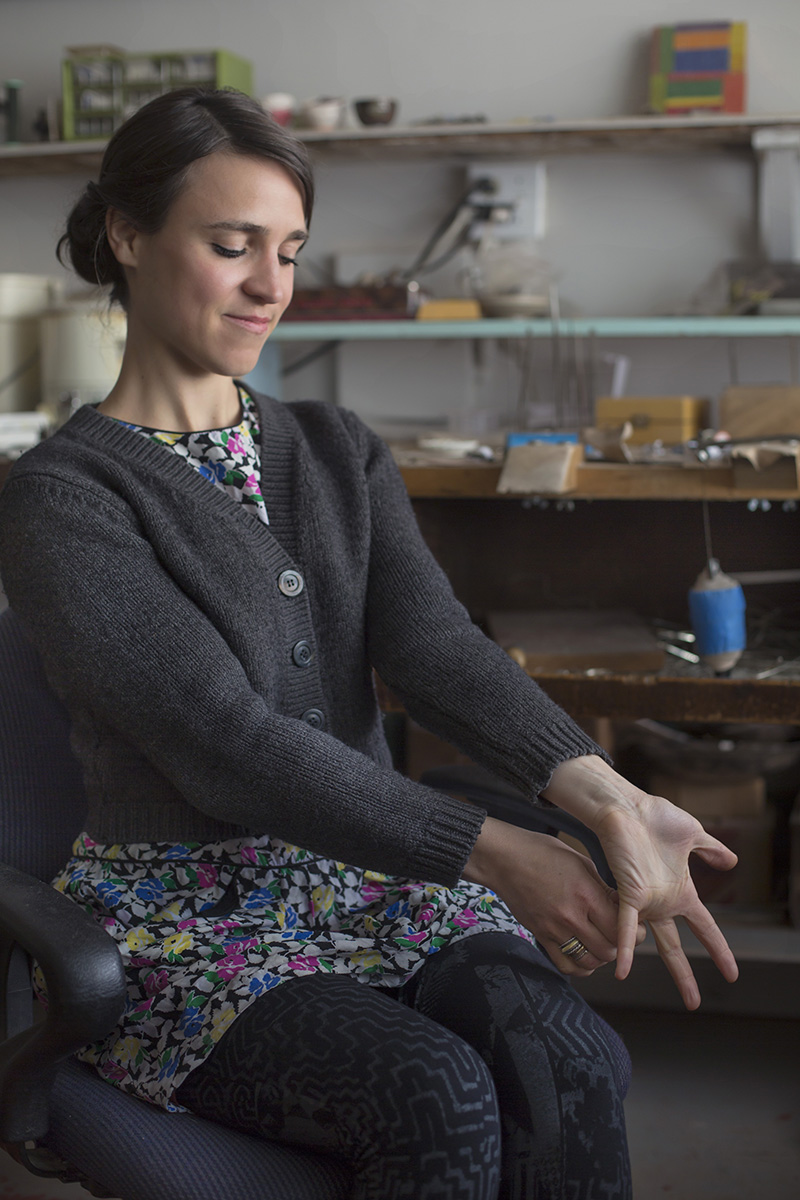 raissa wrist stretch in studio