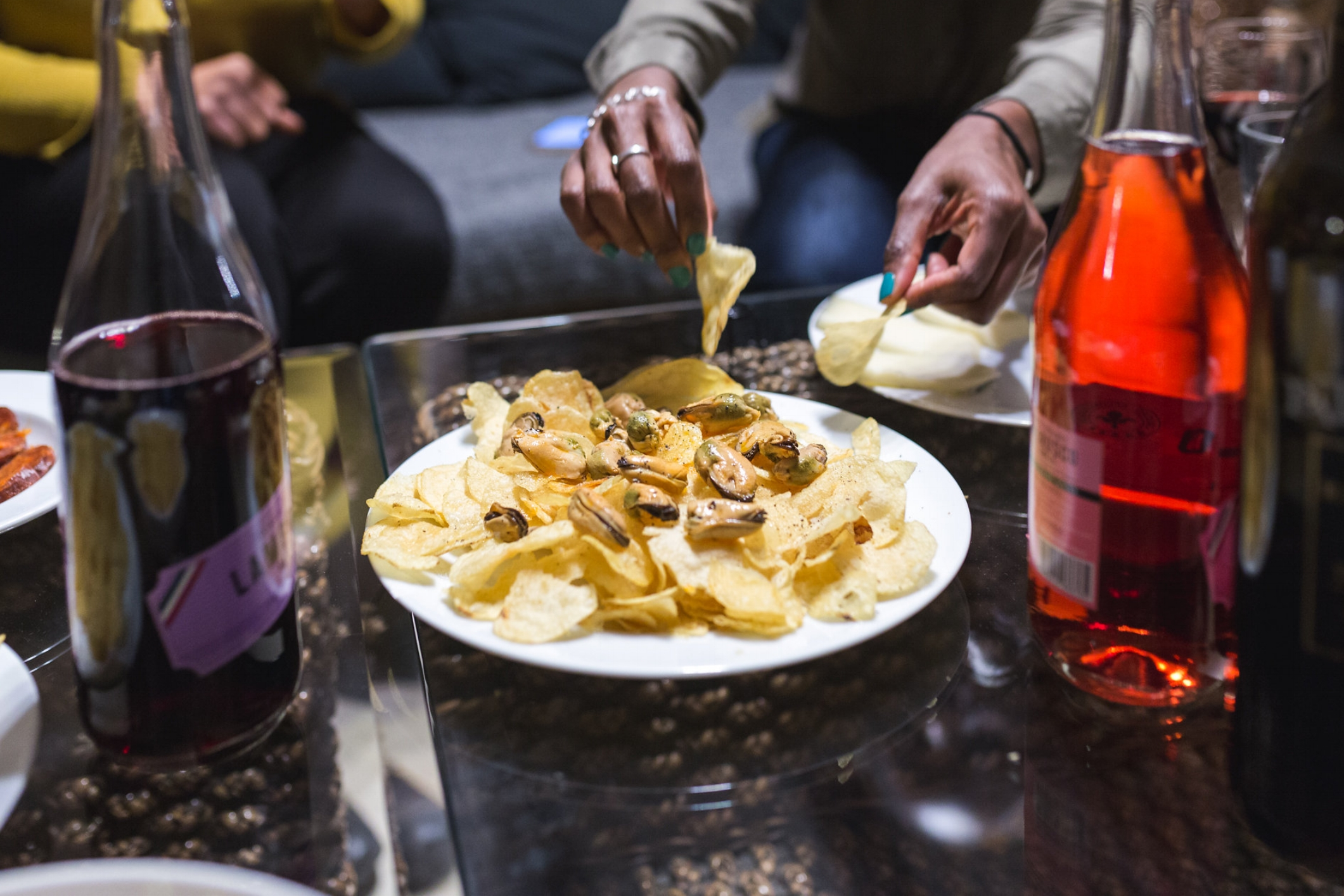 Mejillones en escabeche  on top of potato chips and sprinkled with salt and pepper (Photo by Tanya Weekes)