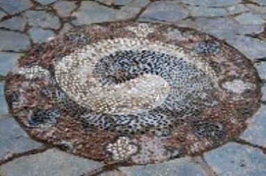 Yin and Yang represented in symbol on walkway