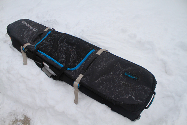 The DAKINE High Roller bag is the king of snowboard/ski bags. I've used this bag for 20 plus trips across North/South America.  I've dragged it down stairs, put it on trains, trucks and subways. It's got all the right pockets and space for everything you need to make a trip stress free.  It's tough, water resistant and you can even take a nap on it.  I also once saw one run over by a car and it came out just fine.  Bomber!    www.dakine.com