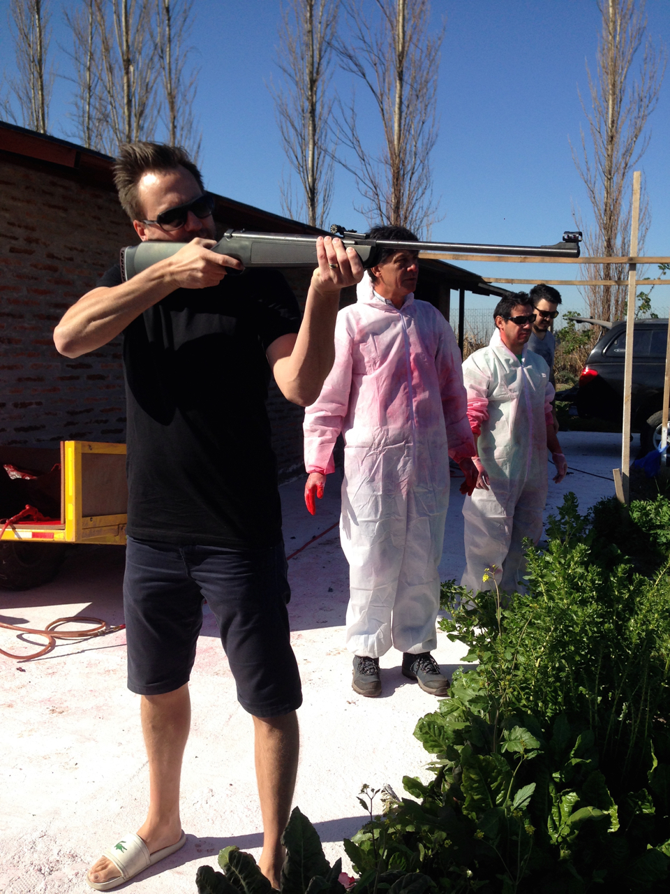 Director Mark Zibert tests some possible special FX with an air gun.