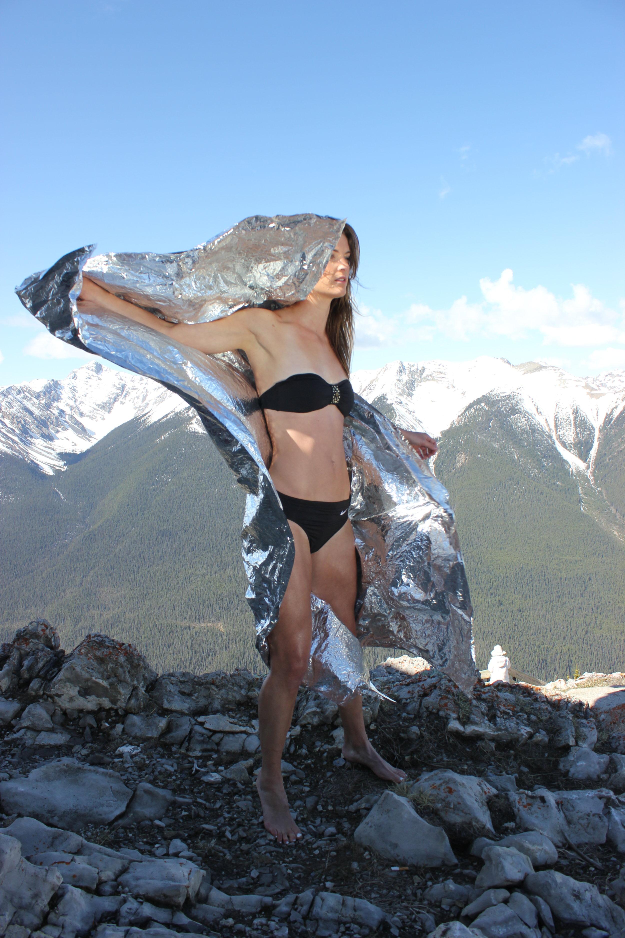 Mountain top props and Javelin athlete Rachel Machin. Banff, Alberta, Canada