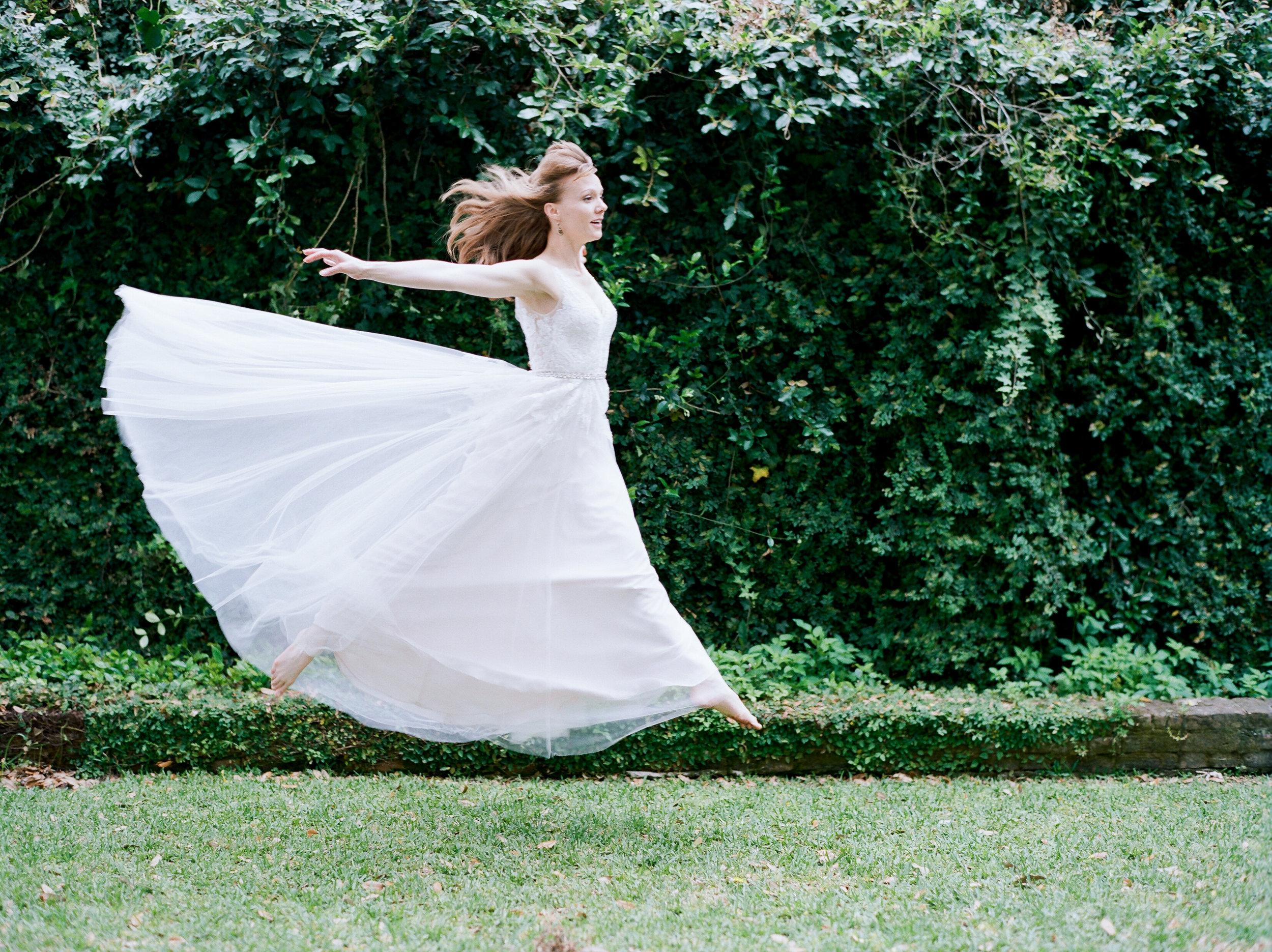 bride jumping, wedding dress flowing