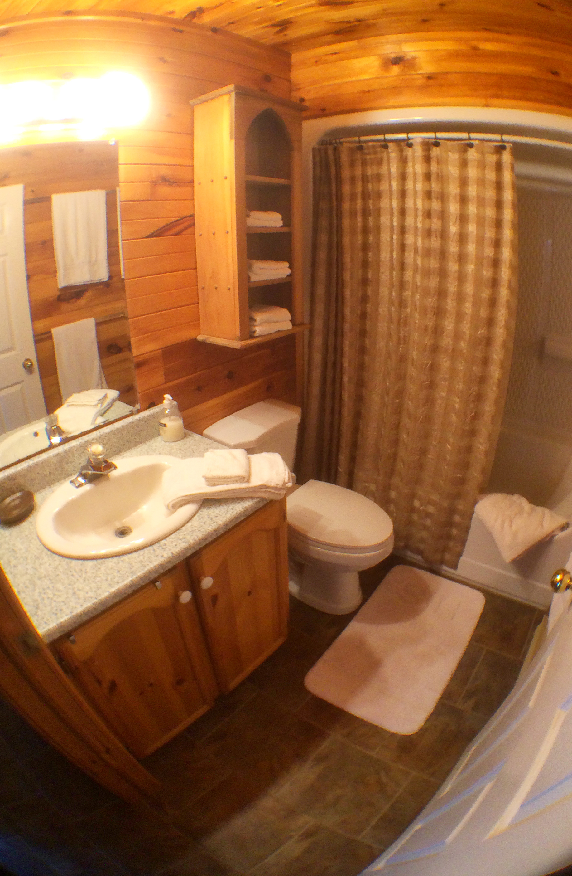 Full bathroom with linens provided