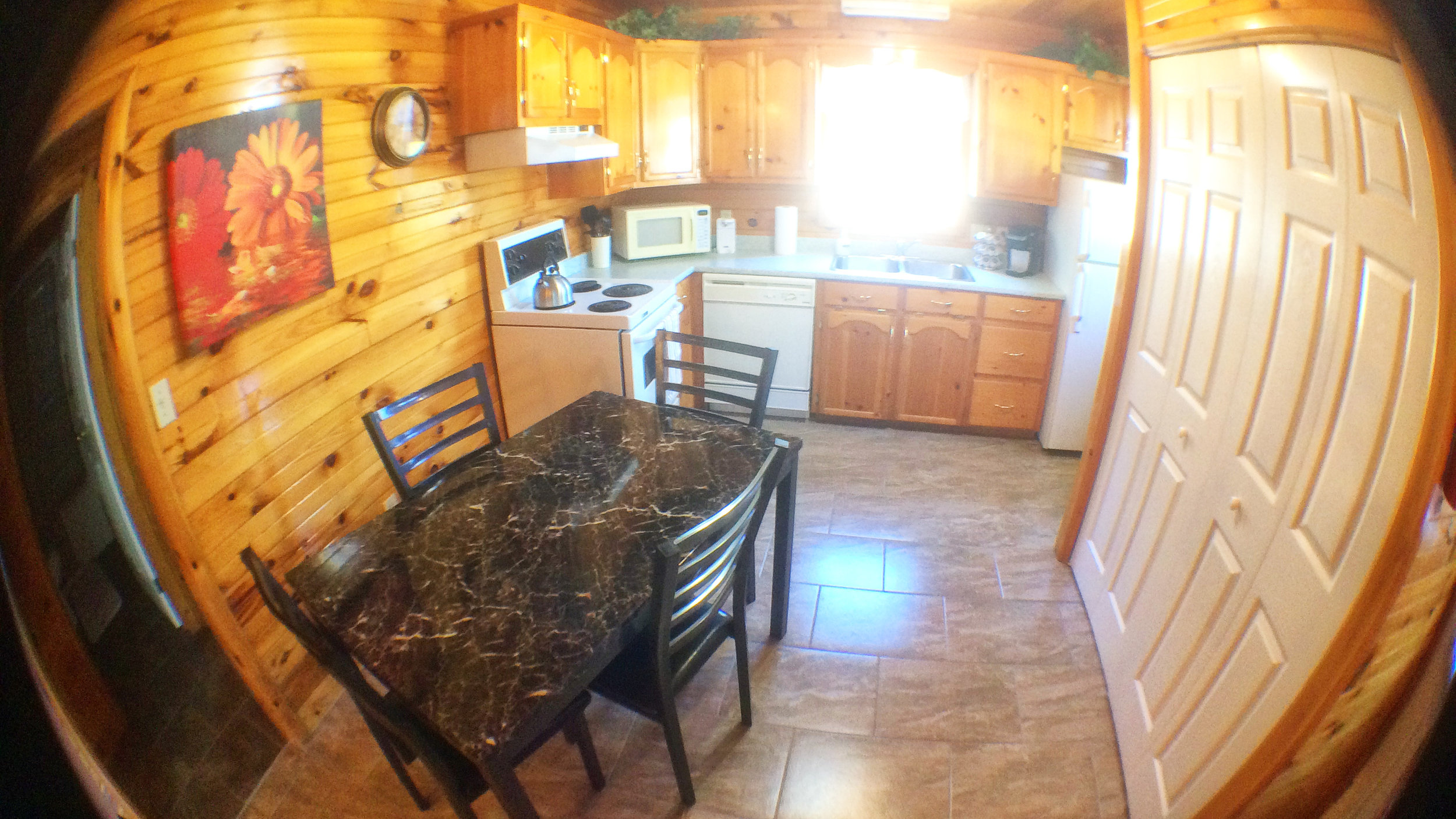 Full kitchen and dining area with seating for 4