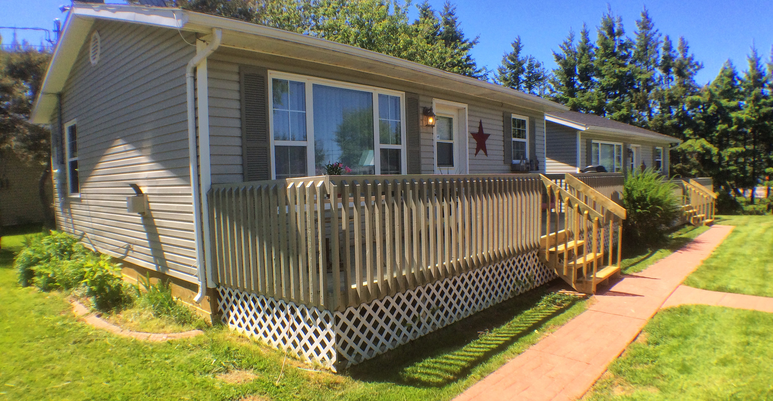 Cottage exteriors with decks and barbecues
