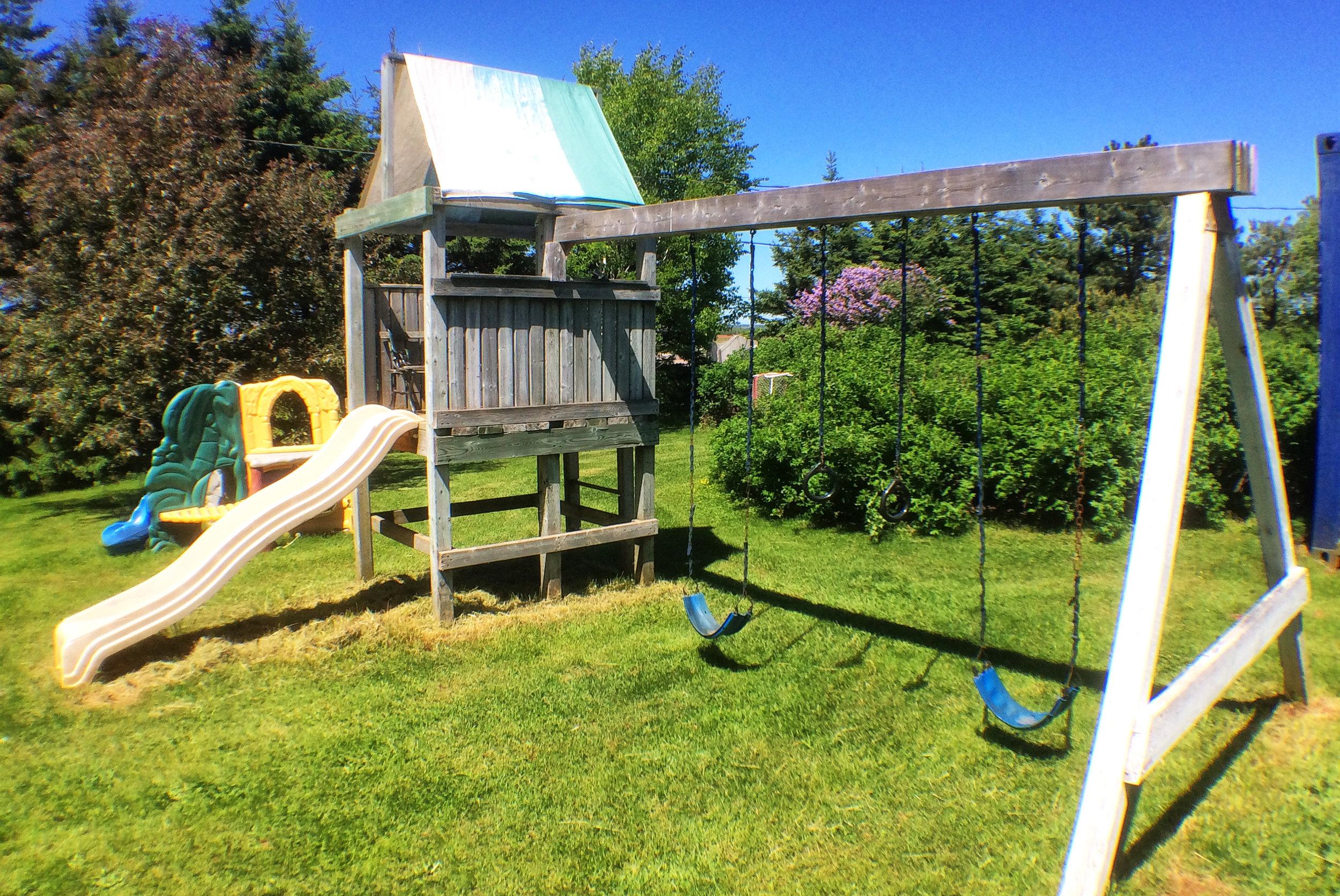 Children's playground with slide and swing set