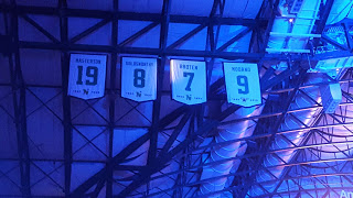 Banners of the Dallas Stars retired numbers up in the rafters