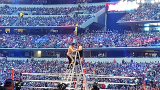 Sami Zayn and Kevin Owens on a ladder