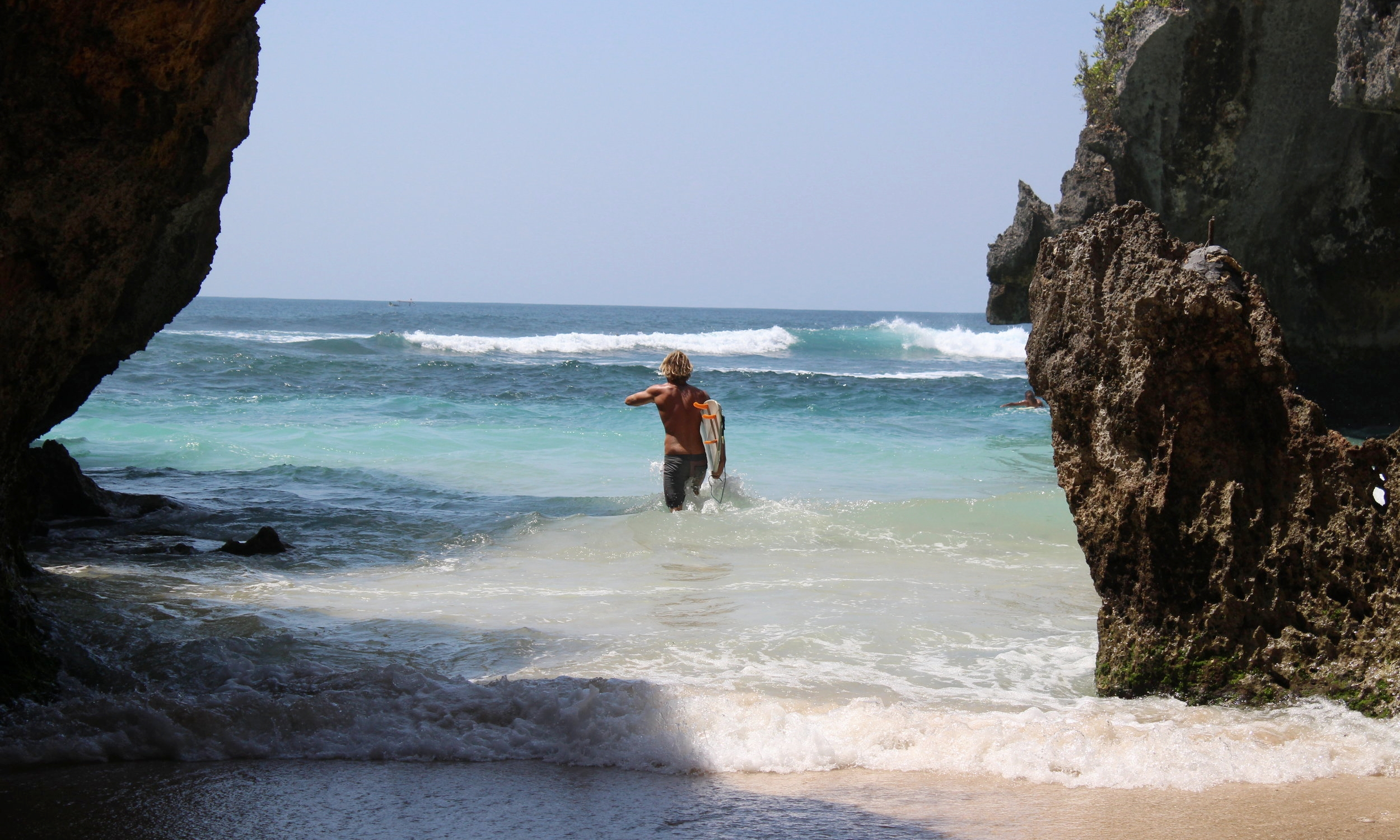 Surfer ready to hit the waves in Uluwatu, Bali. I can't wait to explore more of Southeast Asia.