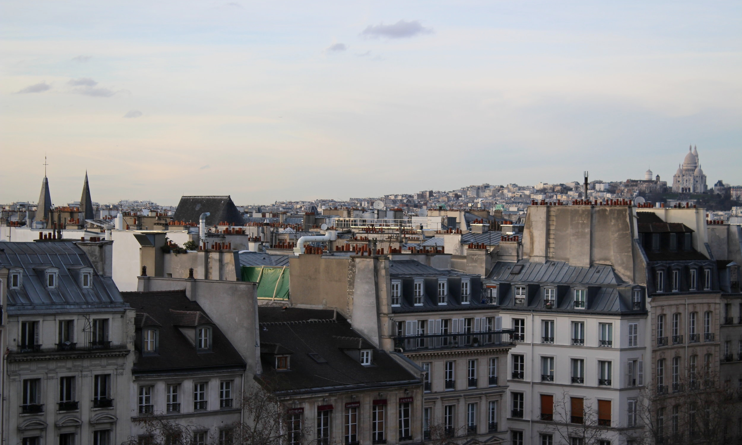 Beautiful sunset views in Paris. Taking photos from the top of Centre Pompidou
