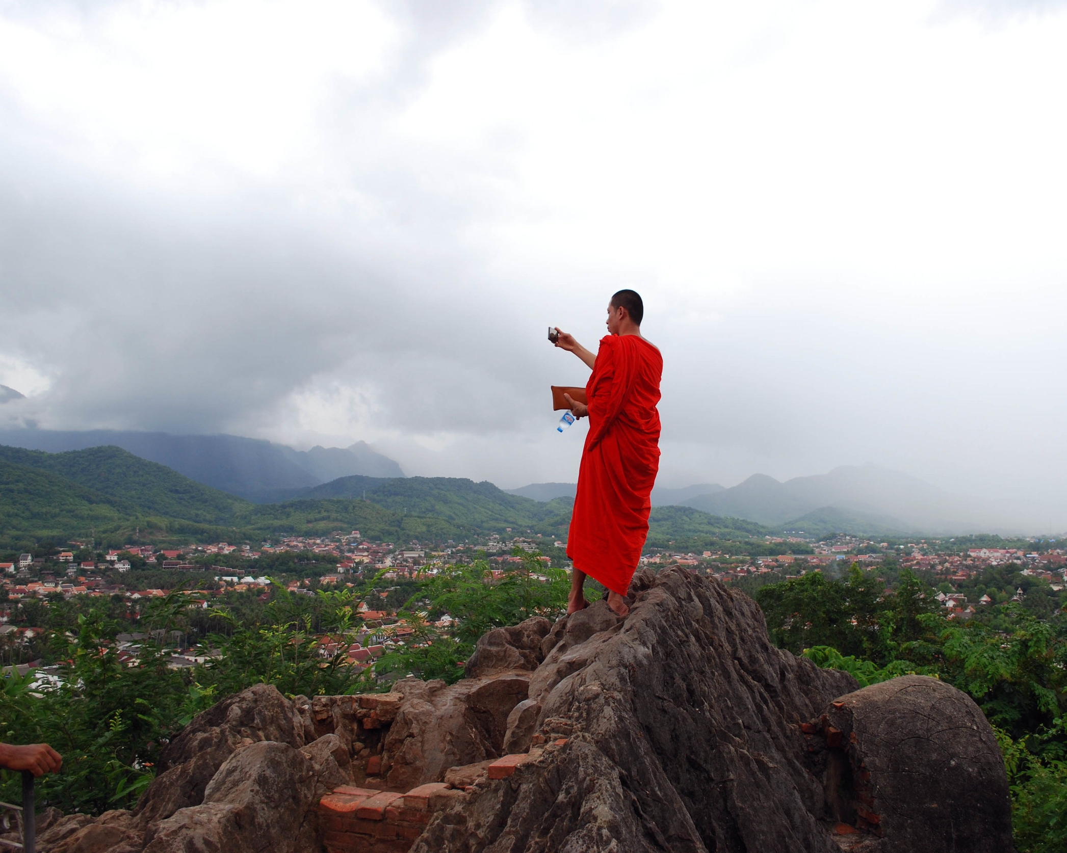 Monk at the top of Mount Phousi