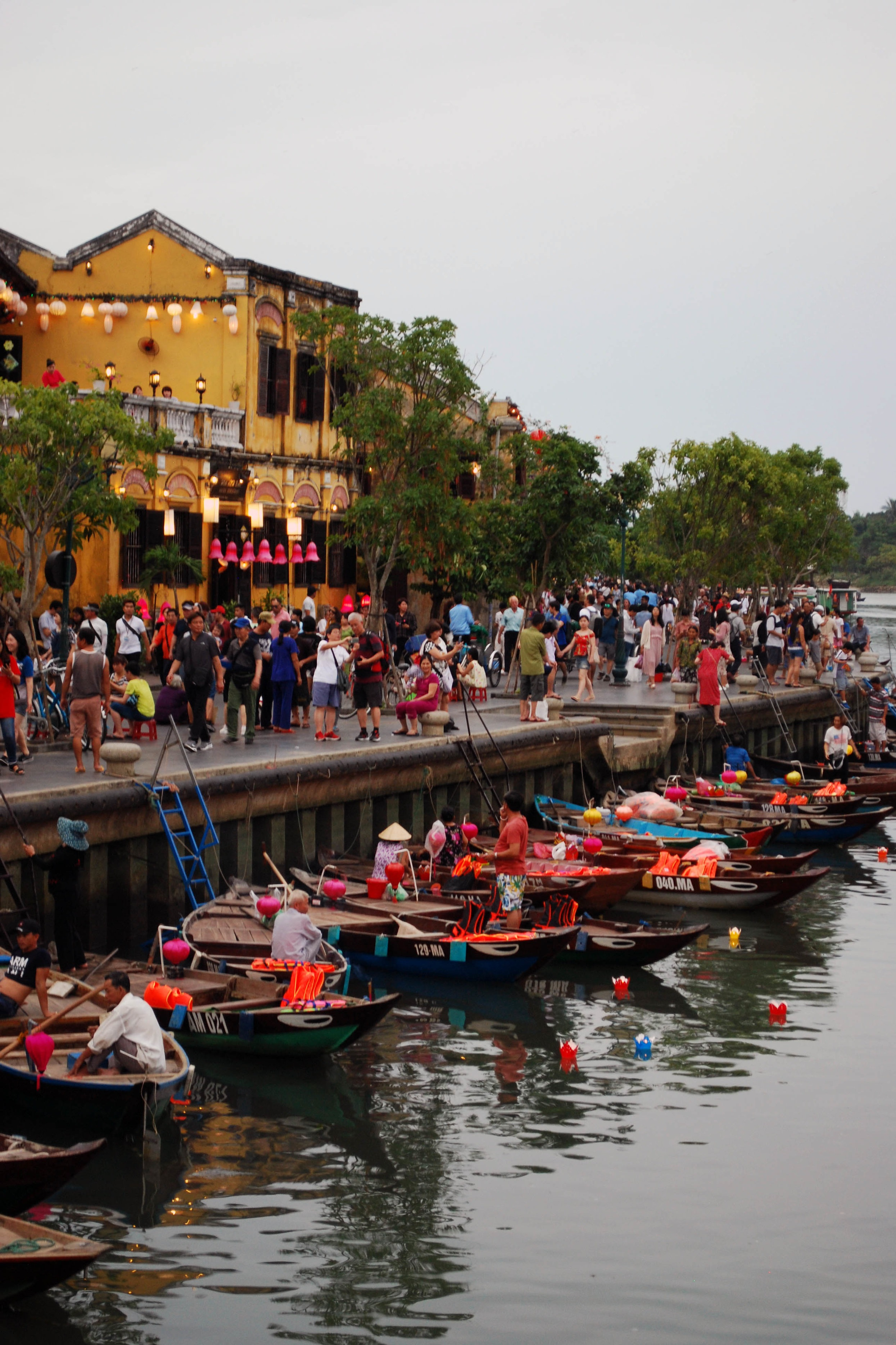 Tourists boarding boats along the canal