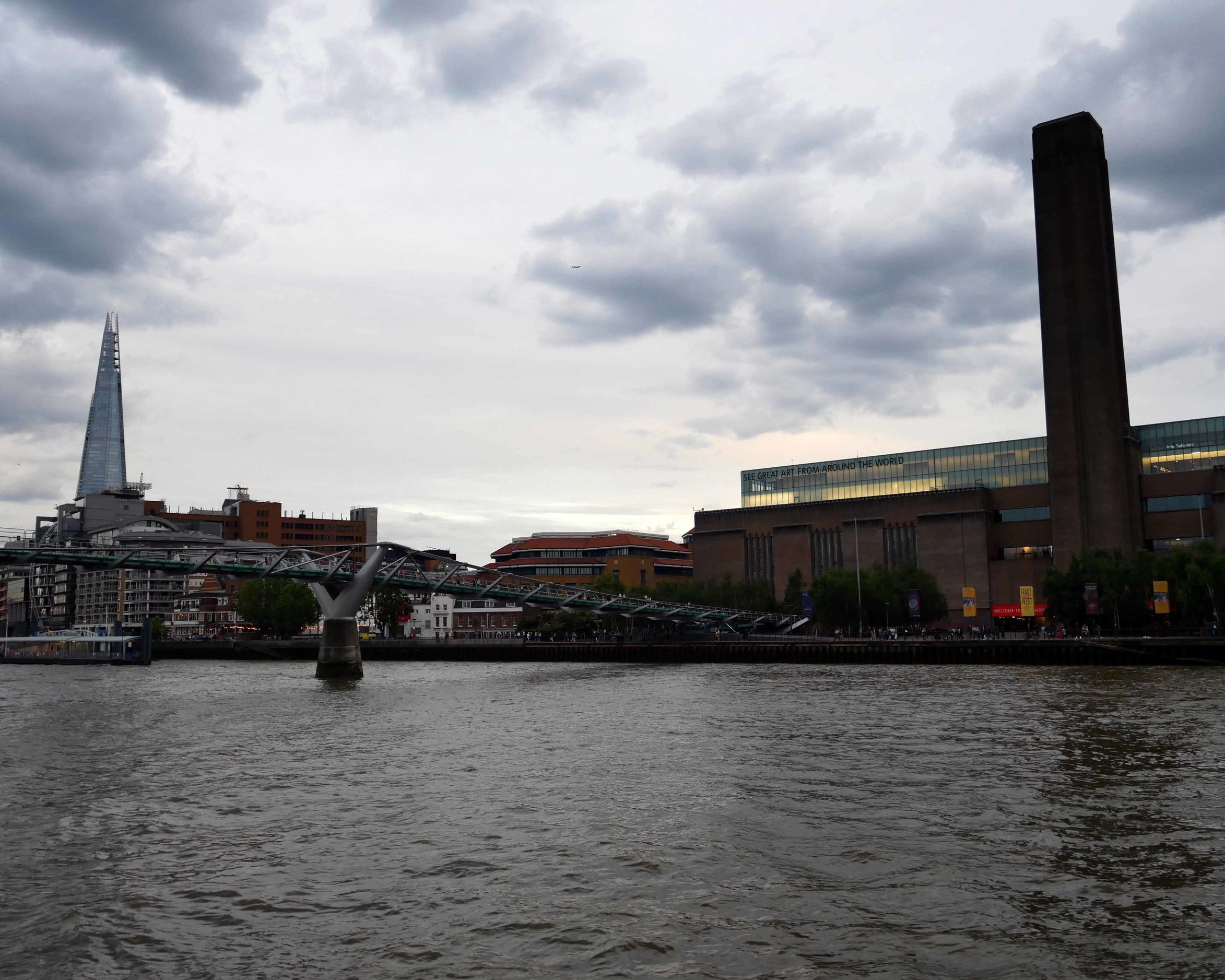 Views on Tate Modern and Millennium Bridge from a London boat party