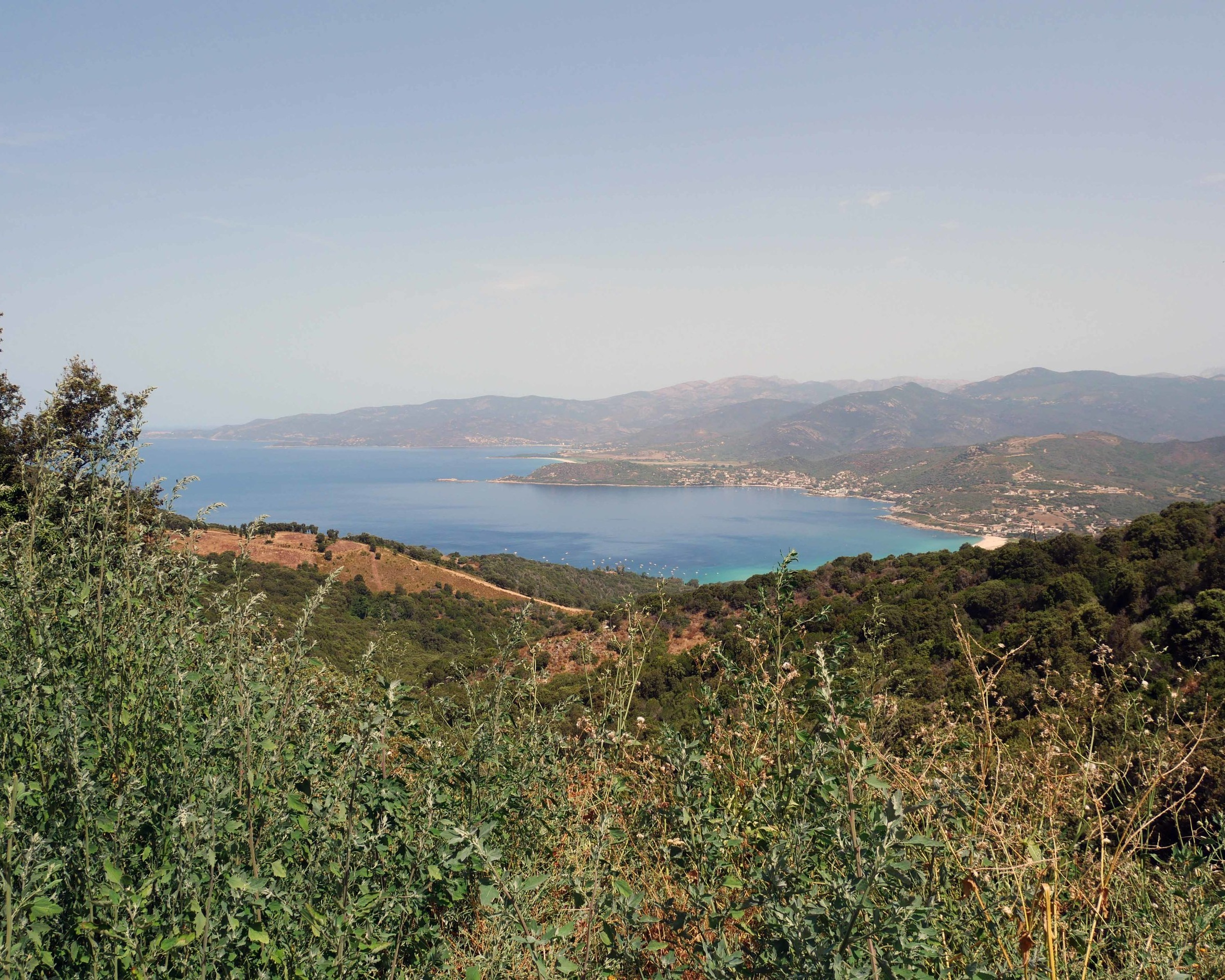 Scenic drives through the Corsican mountains, with views of Corsica beaches in the distance