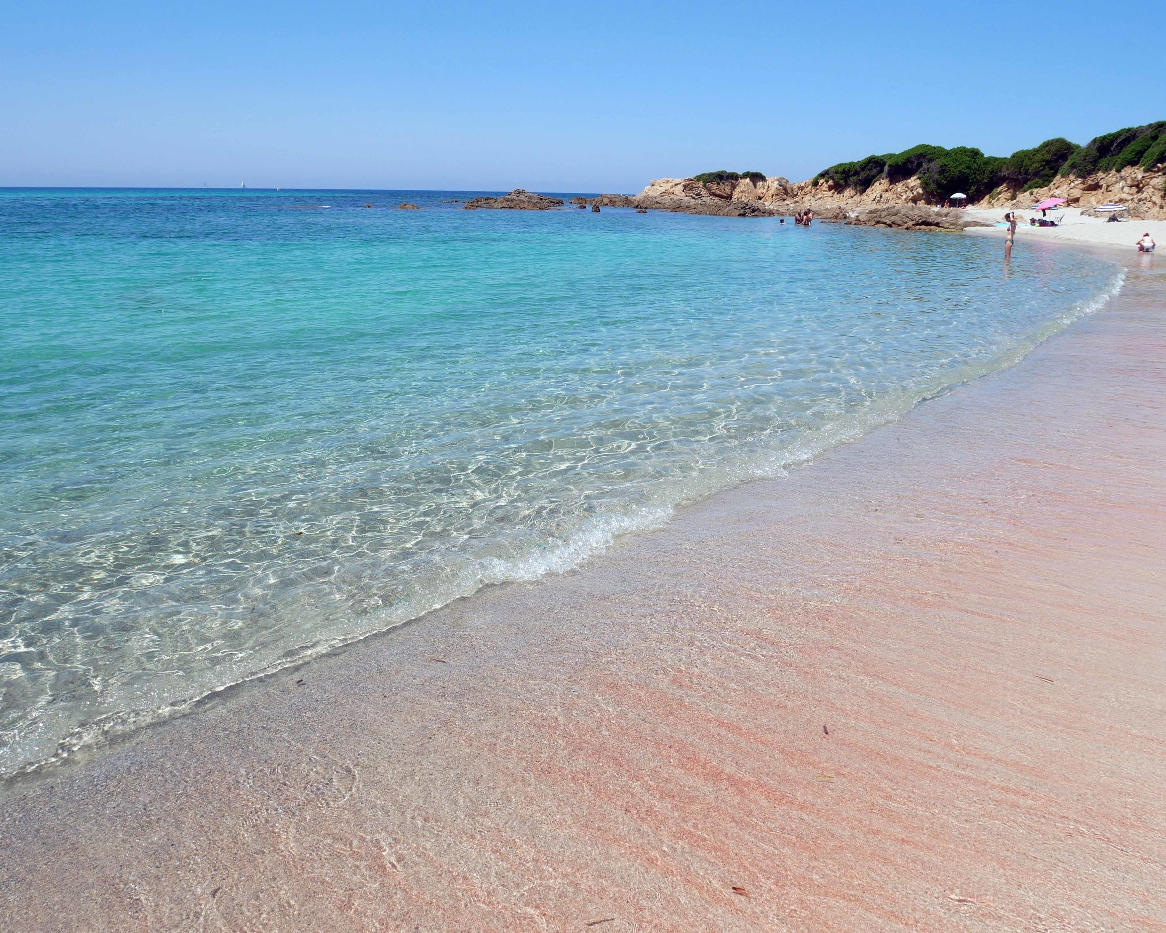 Pink granite from the island's mountains merges with the Corsican sea