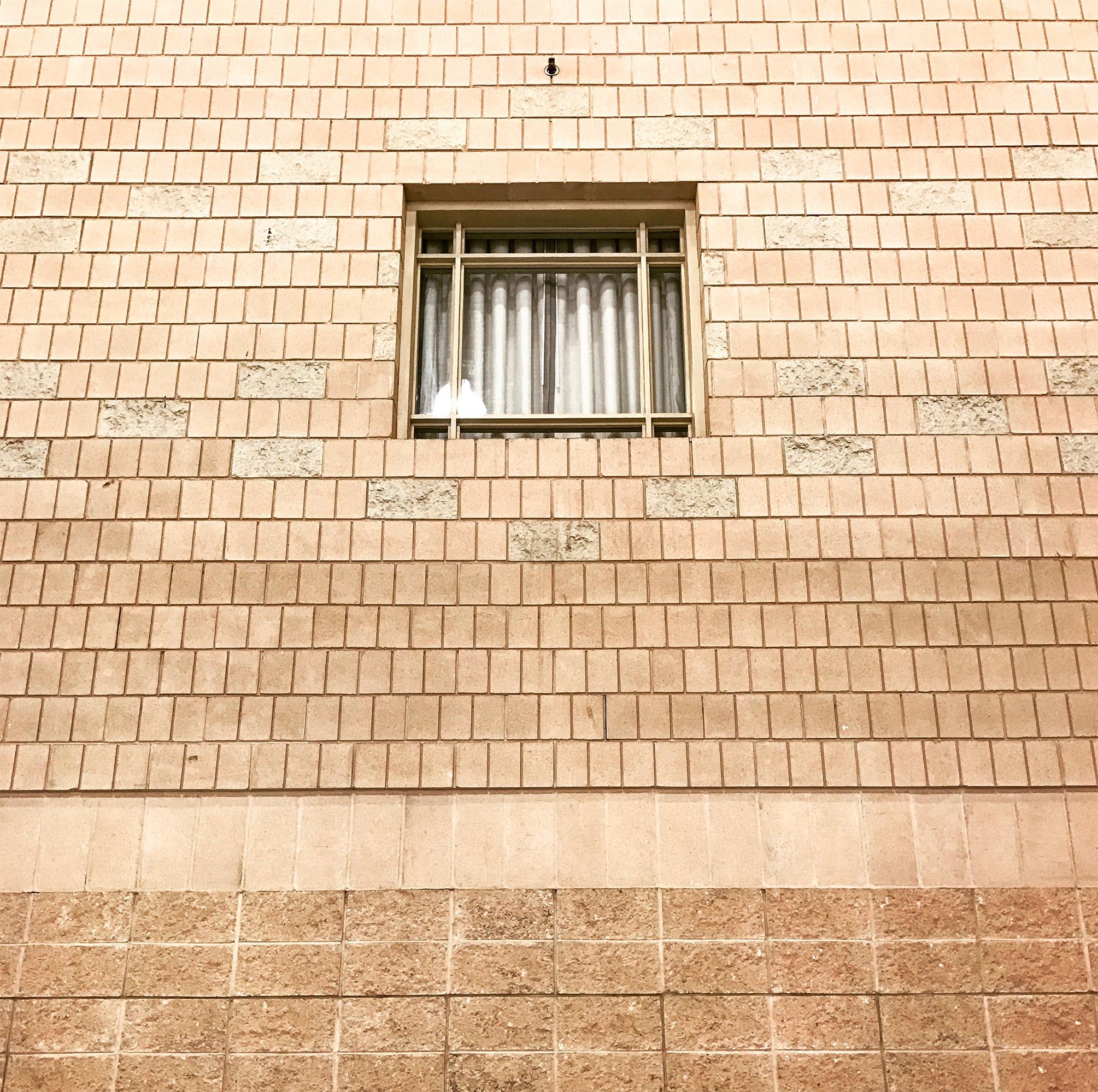 Peach Bricks Centered Window