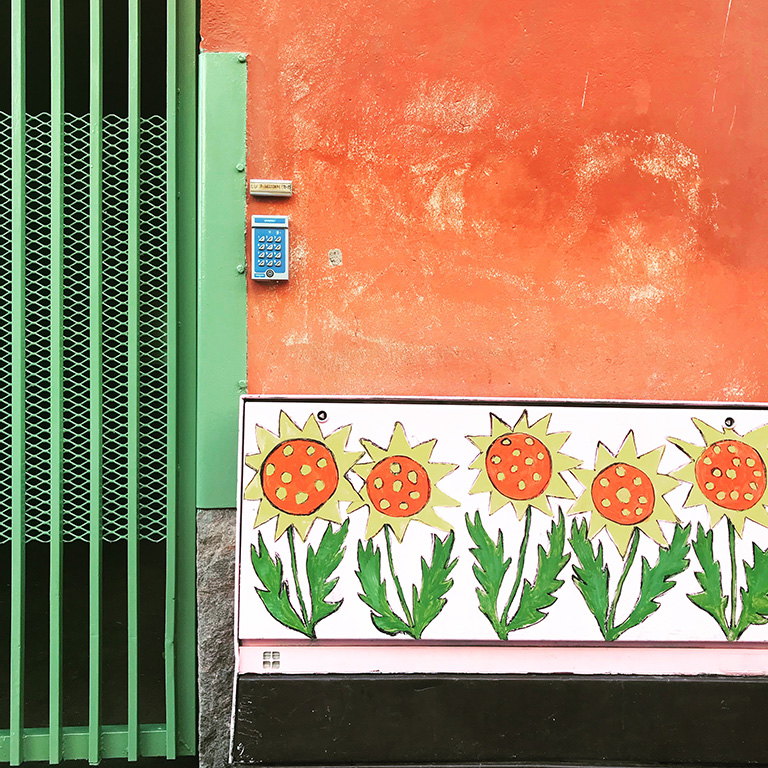 Orange Wall with Sunflowers