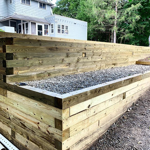 This completed 6x6 timber retaining wall is phase 1 of a multi-year project at the fabulous @grayhavenmotel. We love working with these guys. Up next: a patio!