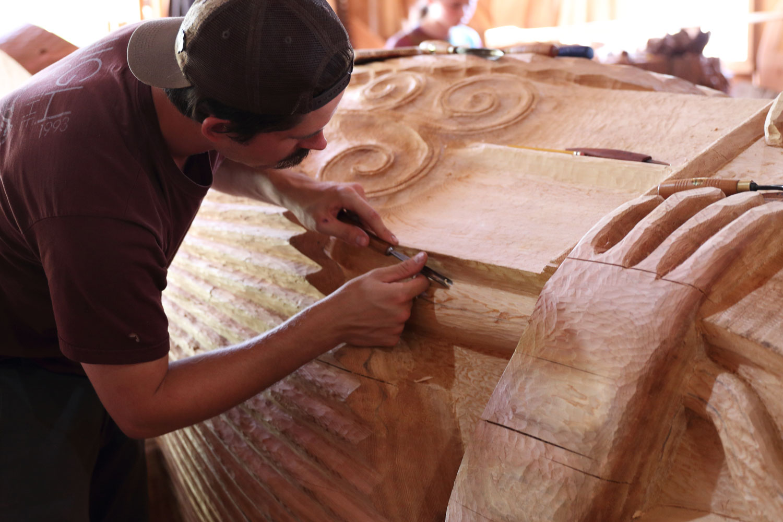 Carving a totem at the Kasaan Native Carving Shed Kasaan Alaska Prince of Wales Island