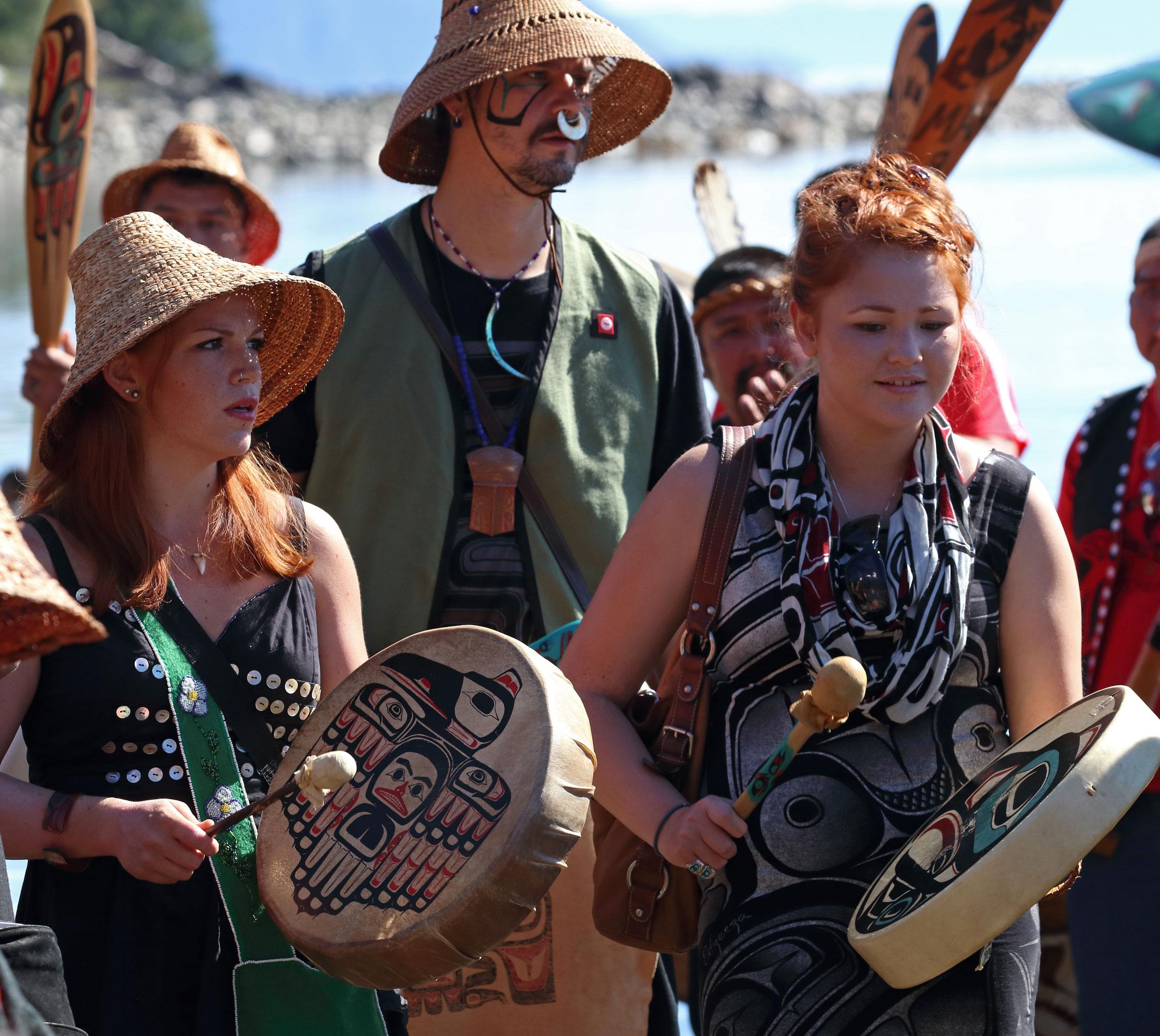 Alaska Native drummers celebrate the Chief Son-I-Hat longhouse in Kasaan Alaska