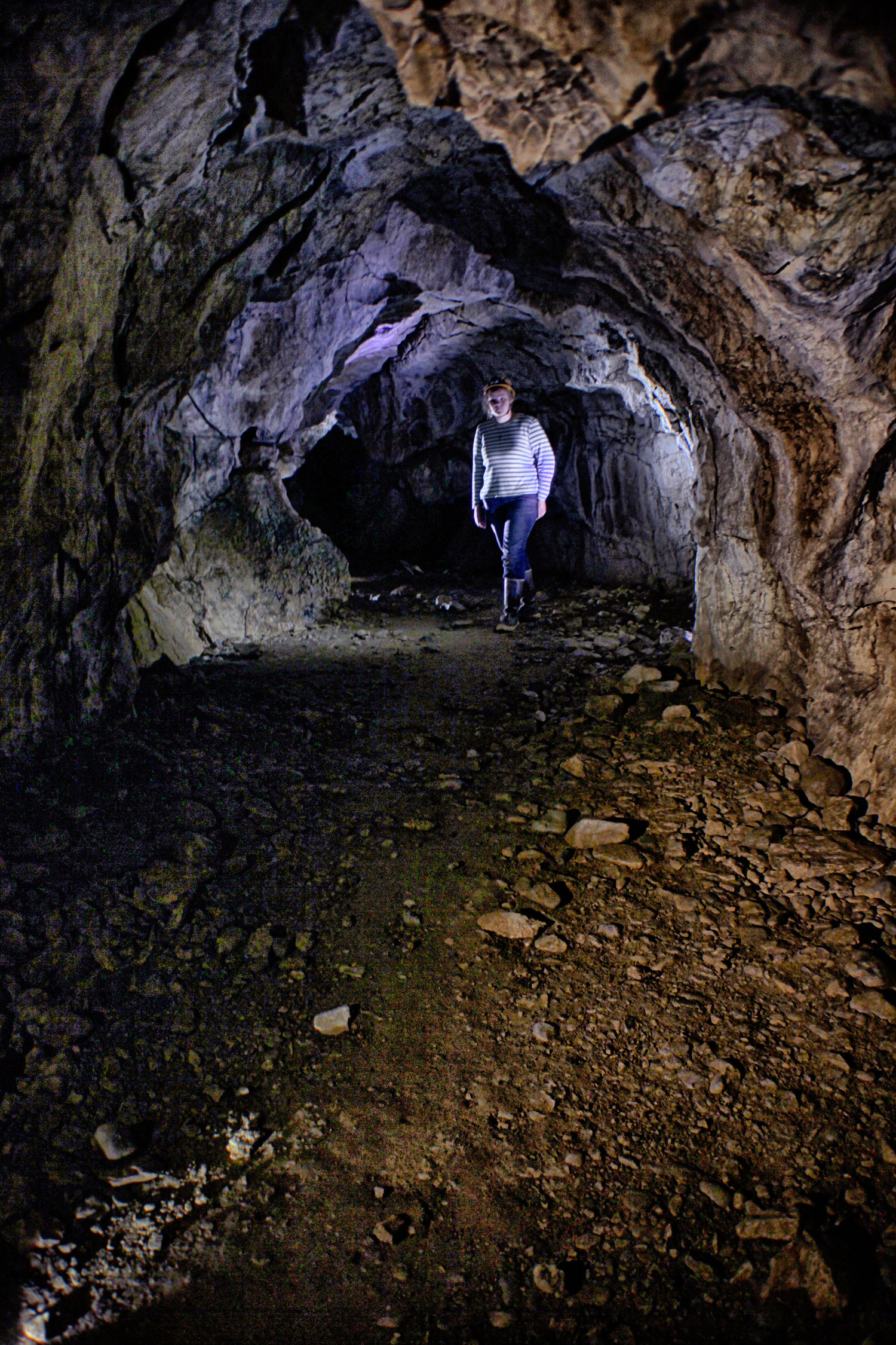 Jessica Petty, a POW local, walking through El Capitan Cave. This portion of the cave is outside the bat gate, and is accessible without a guide or reservation. It is the easiest walking portion of any part of the cave. Photo by Brooke Kubby.