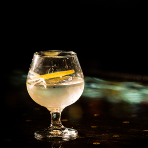 TRISTESSA   • 1.5 oz. Por Siempre Sotol • .75 oz. Cocchi Americano • .25 oz. Tapatio 110 Blanco Tequila • .25 oz. Falernum • 2 Dashes Lemon Bitters  • 1. Combine all ingredients in a mixing glass over ice and stir until chilled. • 2. Strain over ice into a brandy snifter or rocks glass. • 3. Garnish with a stalk of lemongrass.