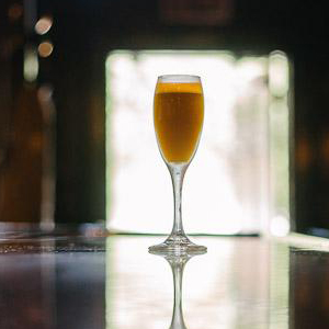 GYPSY'S CURSE   • 2 oz. Amaro Braulio • 1 oz. Dolin Dry • 1 oz. Lemon  • 1. In a cocktail shaker, muddle 3 basil leaves with ingredients and shake with ice. • 2. Fine strain into champagne flute.