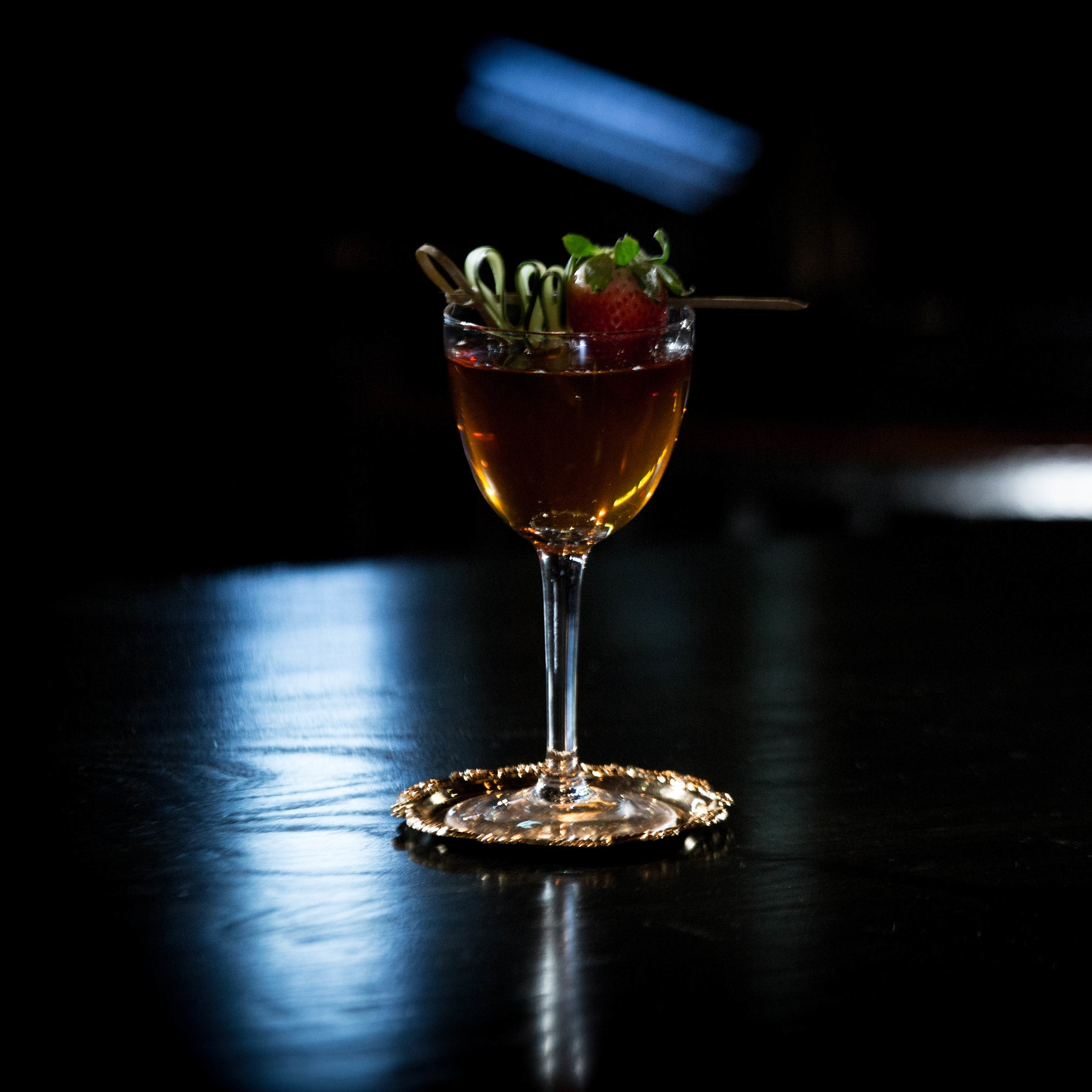 UMBRELLAS IN LONDON   • 2 oz. Manzanilla • 1 oz. Pimms  • 1 bar spoon Canne syrup • 1 dash Orange Bitters  • 1. Muddle   3 cucumber wheels and 1 sprig of mint. • 2. Add remaining ingredients in a mixing glass and stir. • 3. Fine strain into a cocktail glass. • 4. Garnish with cucumber peel skewered through a strawberry.