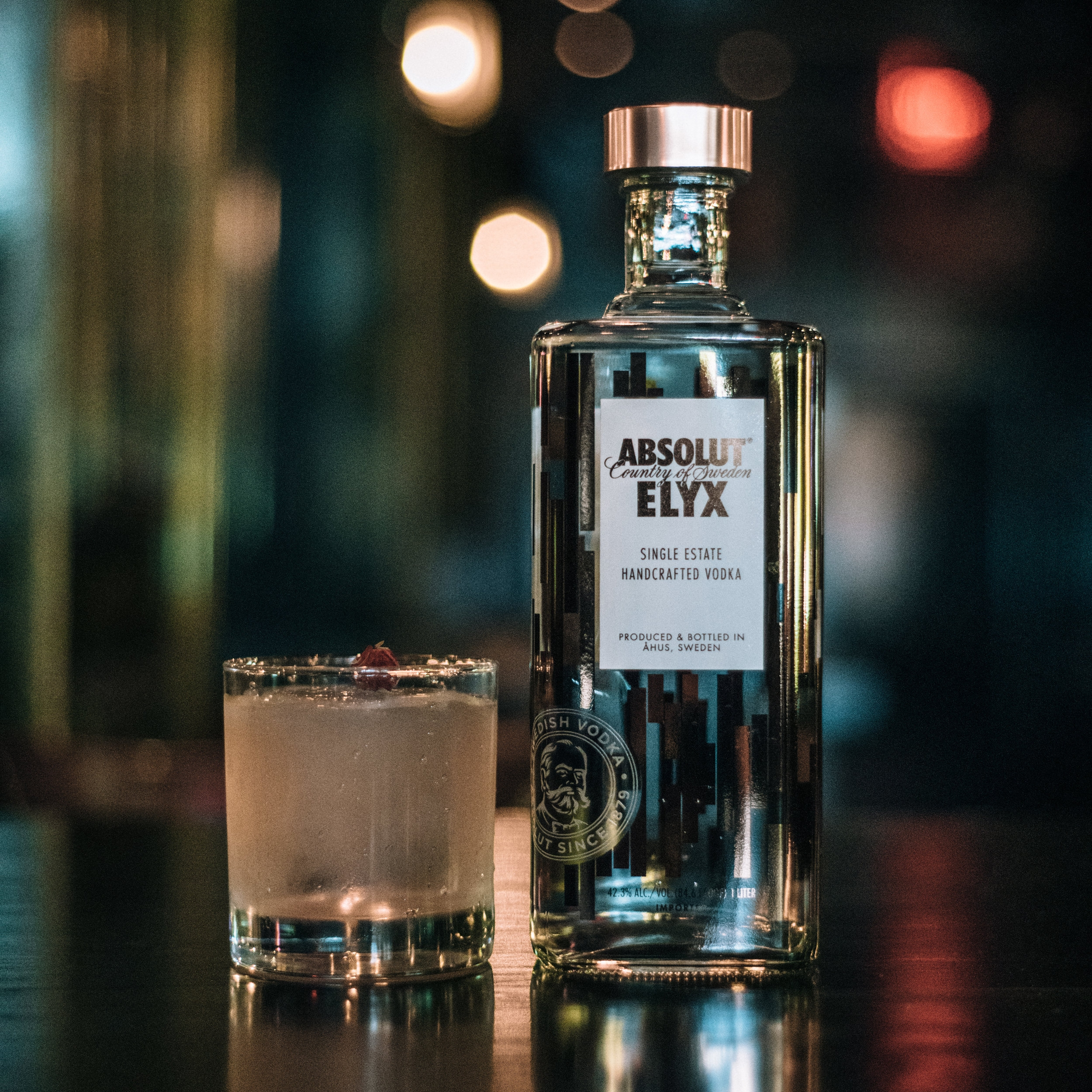 SIX, THREE TIMES   • 1.5 oz. Absolut Elyx • .75 oz. Luxardo   Bianco Bitter • .75 oz. Watermelon/ Basil infused Dolin Blanc  • 1. Combine all ingredients in a Rocks glass   over a big ice cube and stir until chilled. • 2. Garnish   with a rose bud.