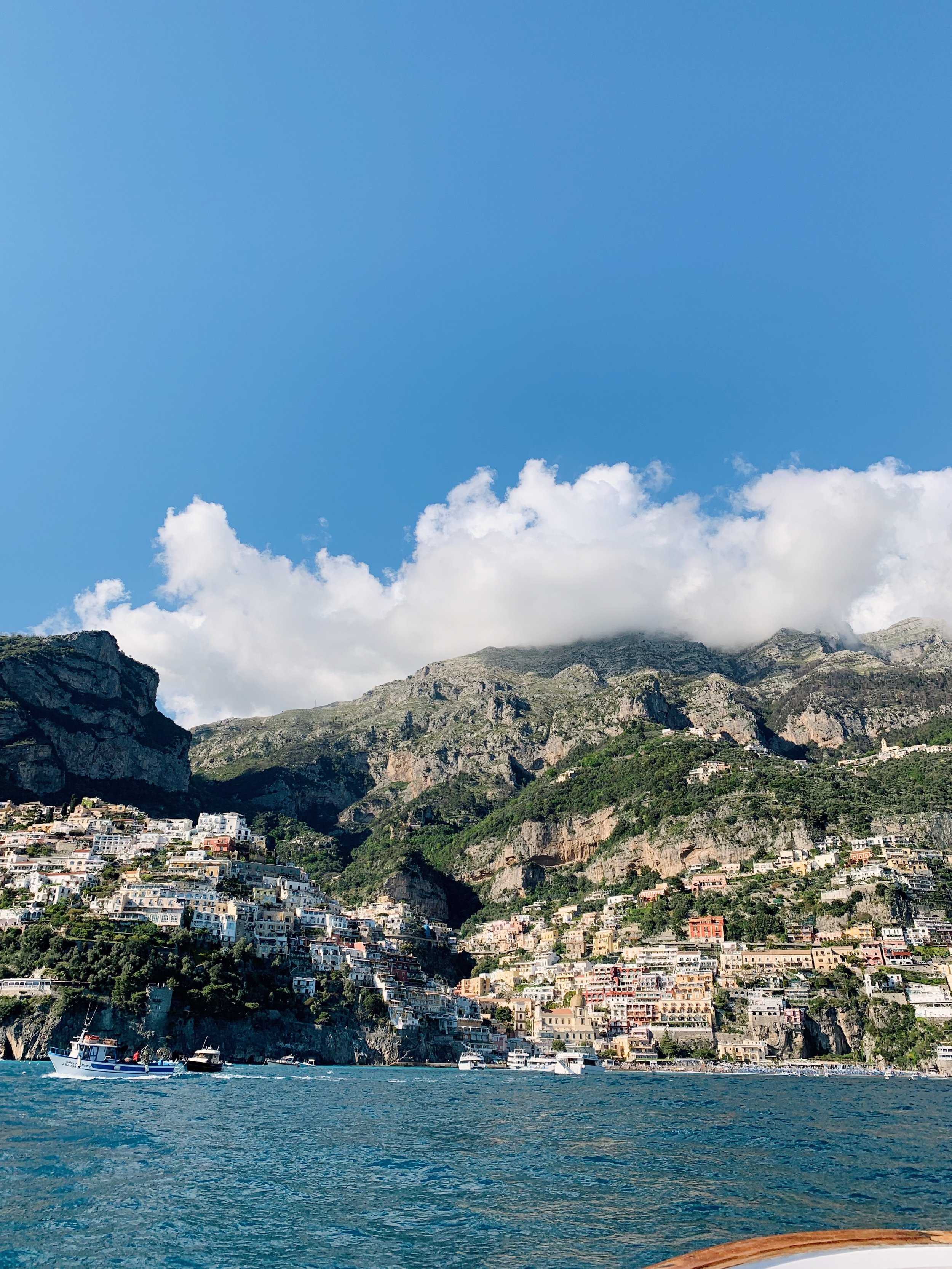 View of Positano from the water with  Positano Boats.