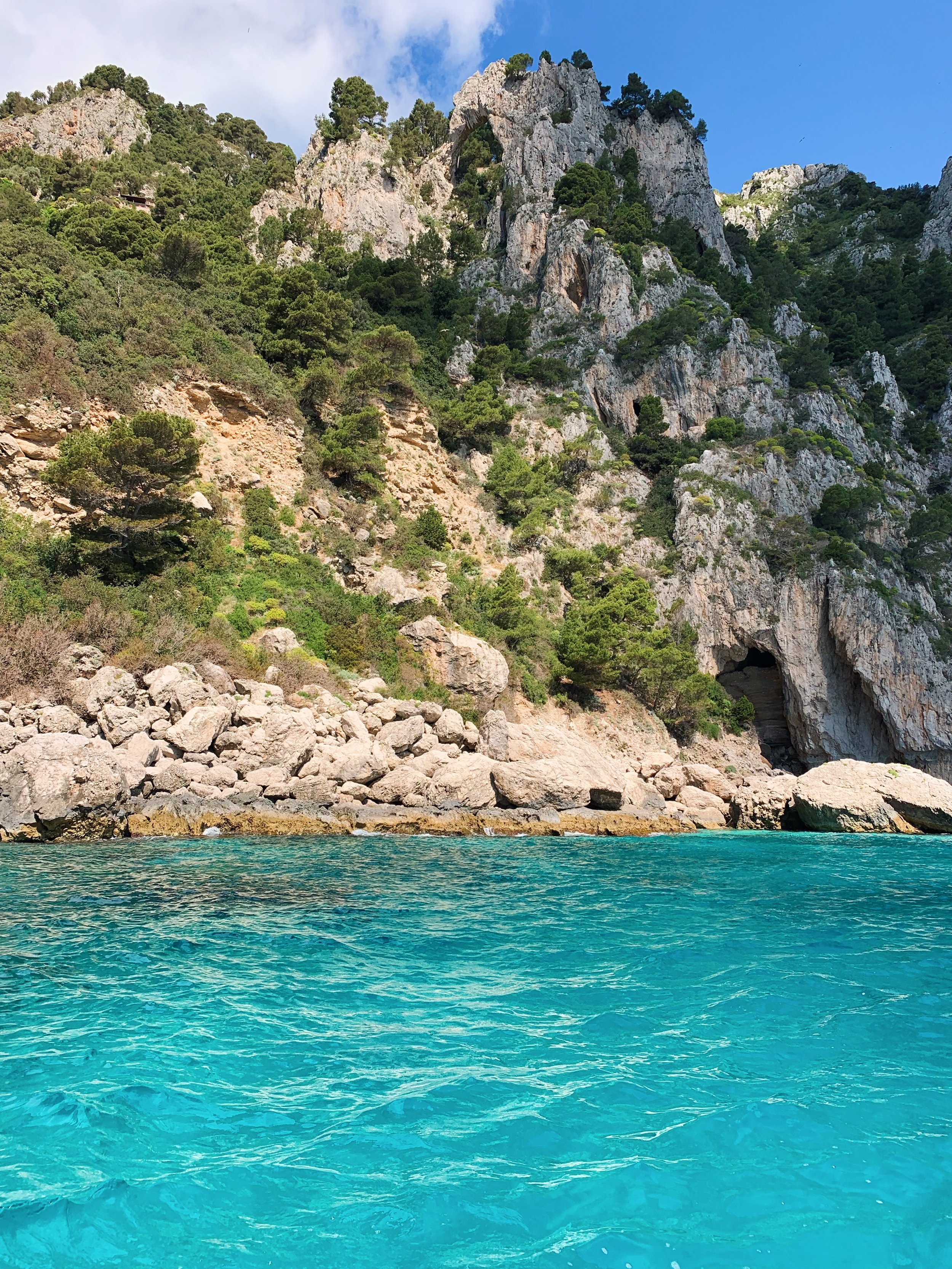 View of grotto at Capri with  Positano Boats.