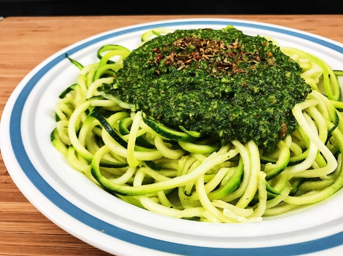 Zoodles topped with pesto