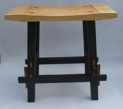 Stool with keyed through tenons and a carved seat.