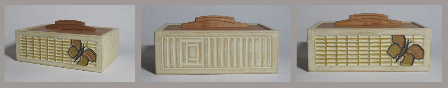 Basswood box with carving and a cherry drop-in lid
