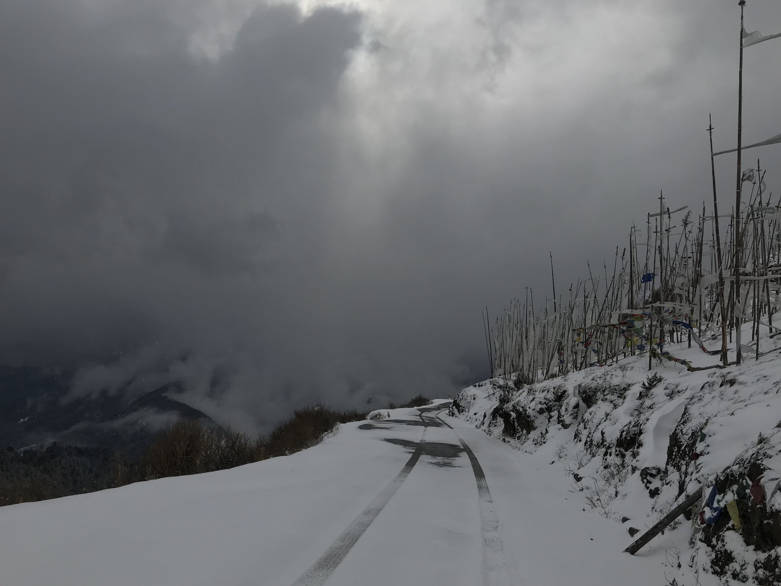 Once we reach the top of Chele La, however, the road is mostly snowed over. Don't look down!
