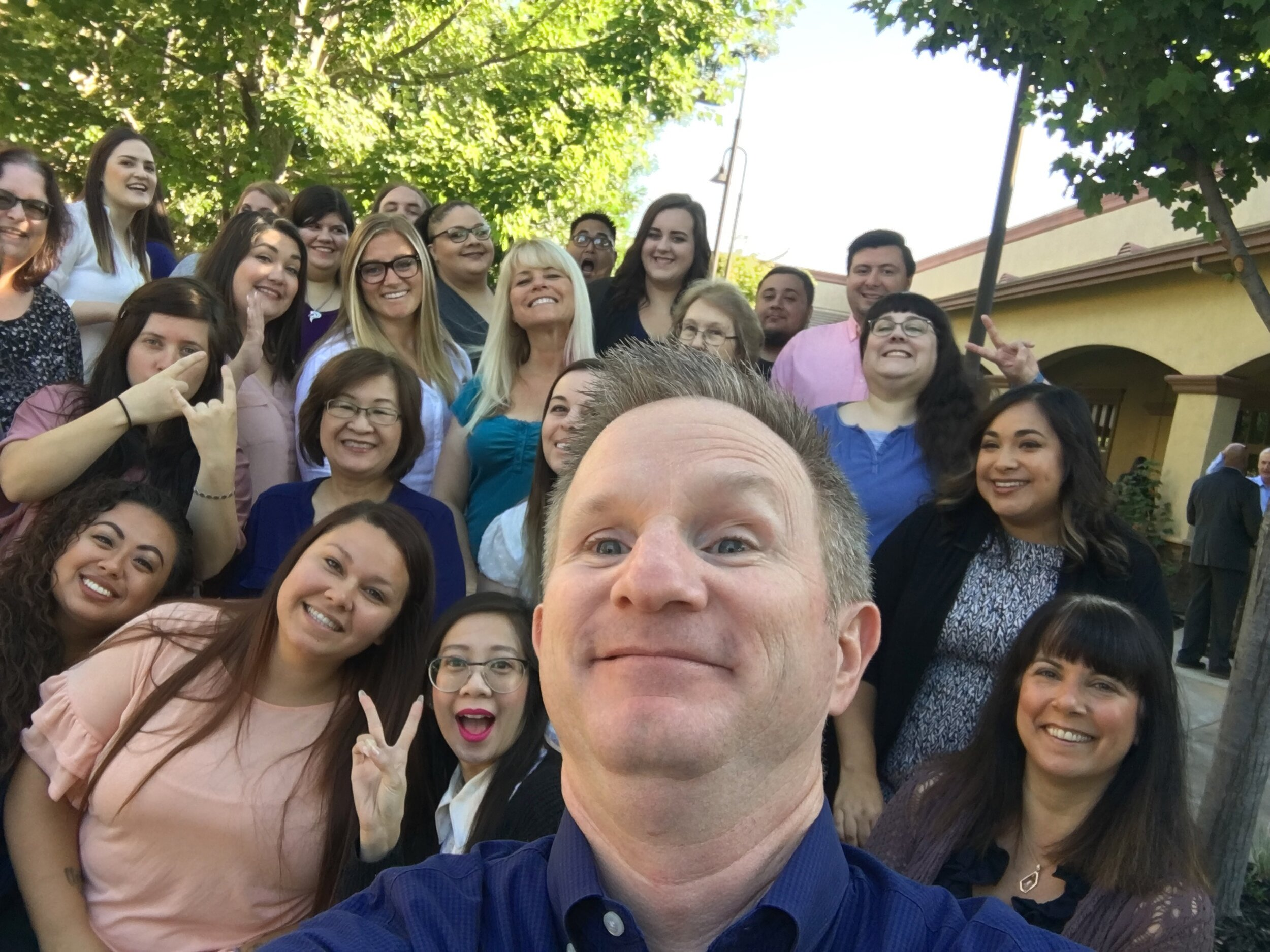 Right before our recent corporate team photo… it's time to take a selfie!