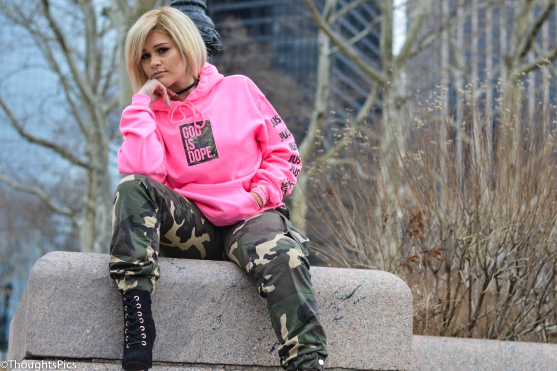 Outdoor portrait in city with girl wearing pink hoody and camouflage   Photographer Thoughts Pics