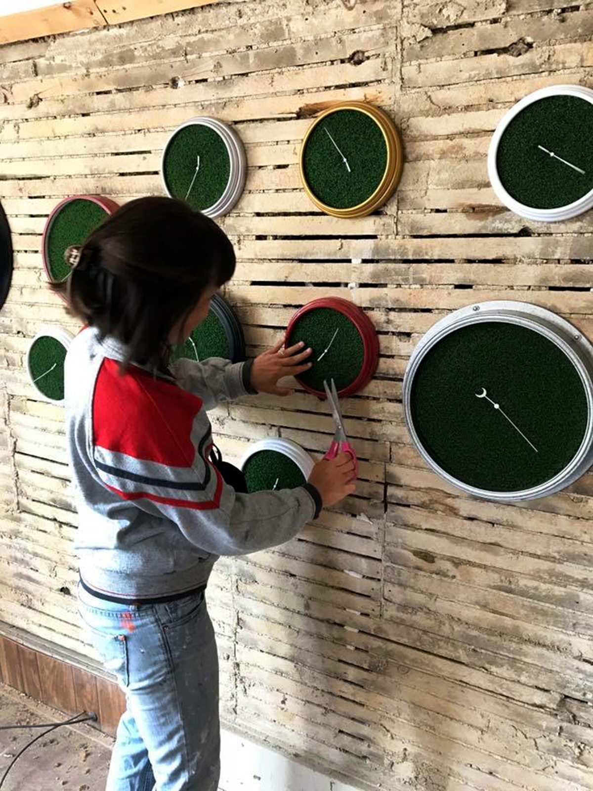 - This installation featured 30 functional clocks in various shapes and sizes that I modified with artificial grass.