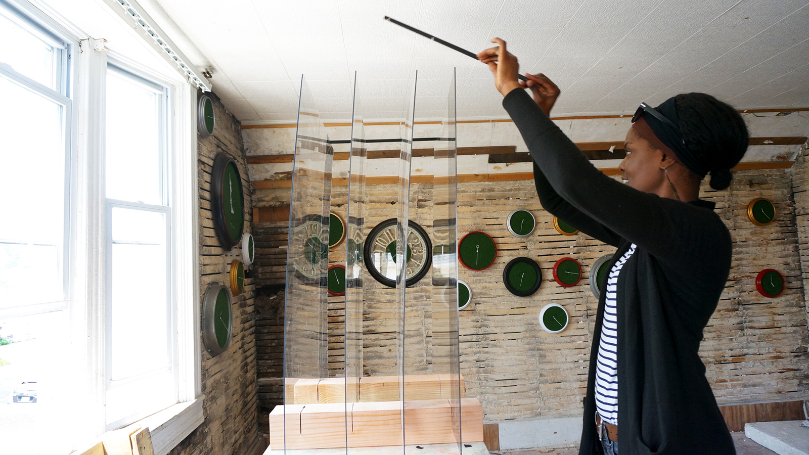- The clocks helped fill one room of the house, intermingling with work from artists Sharon Sevenzo and Christine Ripley.