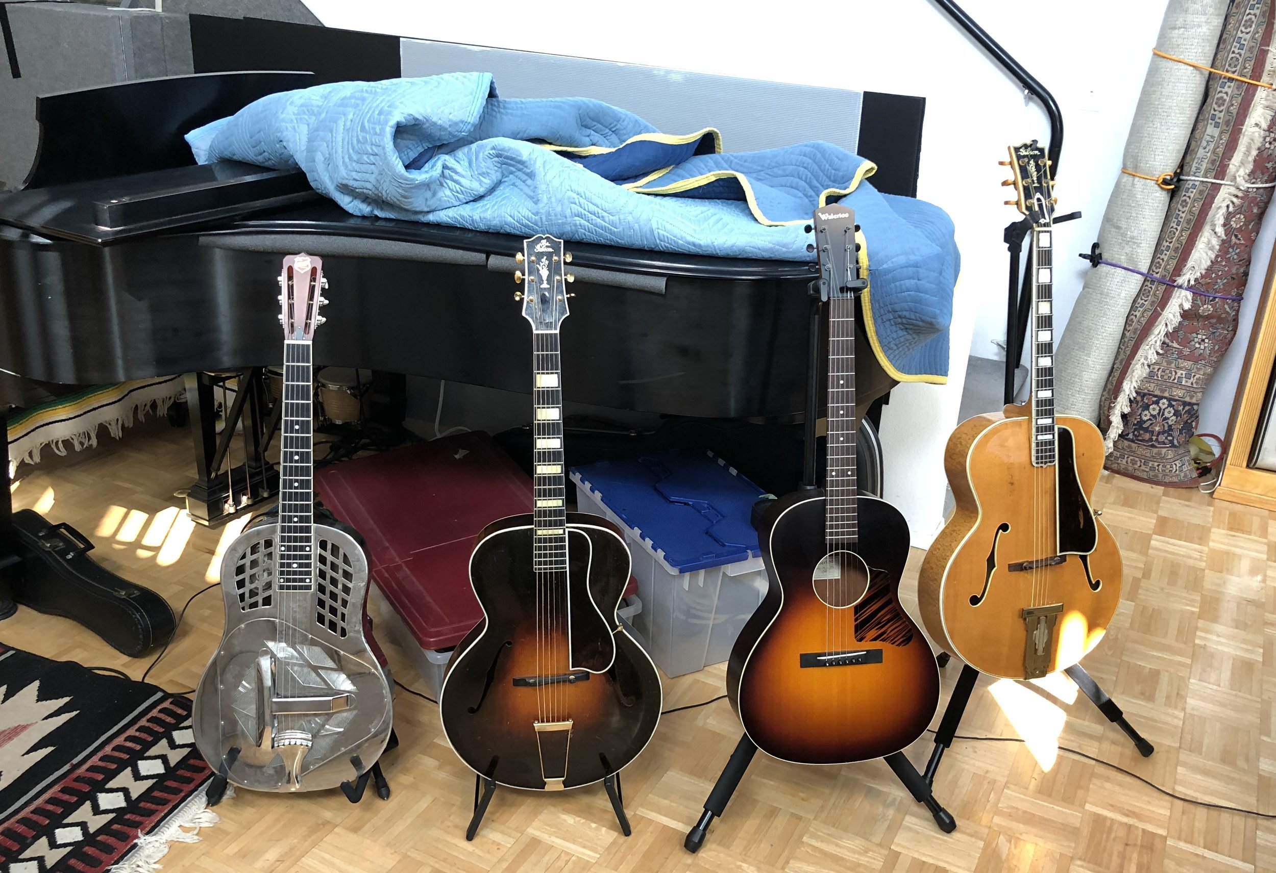 2012 National Style 1 Tricone, 1932 Gibson L-5, 2016 Waterloo WL-14LTR, and a 1939 Gibson L-5