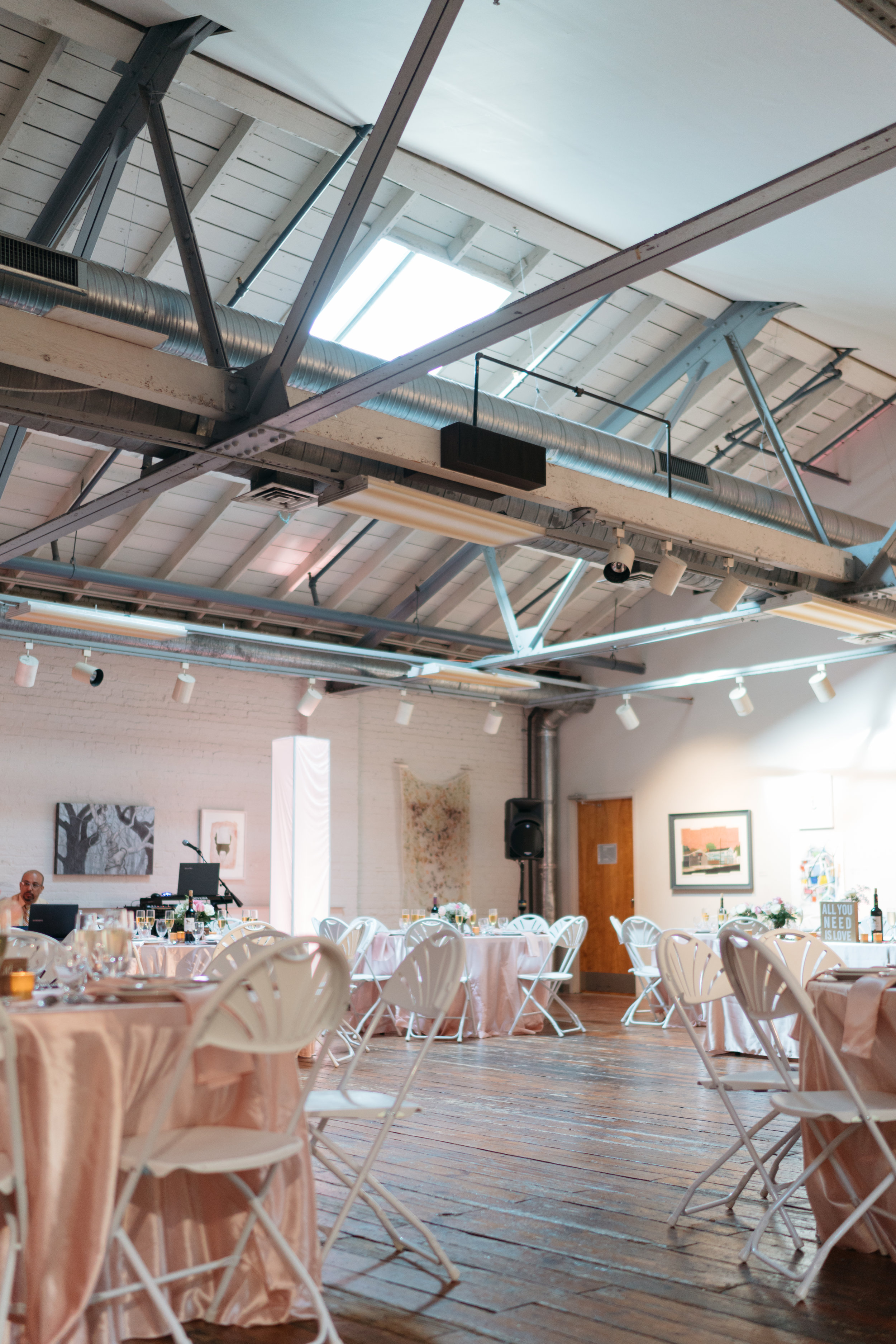 I love the skylight- it brought in the beautiful natural light during our ceremony. We weretotally okay with the white ceiling and exposed beams since we liked rustic venues- we were hoping for something with character. We loved everything about the lighting (skylight and track lights) except the florescent lights- which were not a big deal, we just didn't use them. The wooden floors were a dream as well- we didn't want to ruin the look or charm by adding a dance floor-we teetered back and forth on it and in the end I'm so glad we didn't get one!