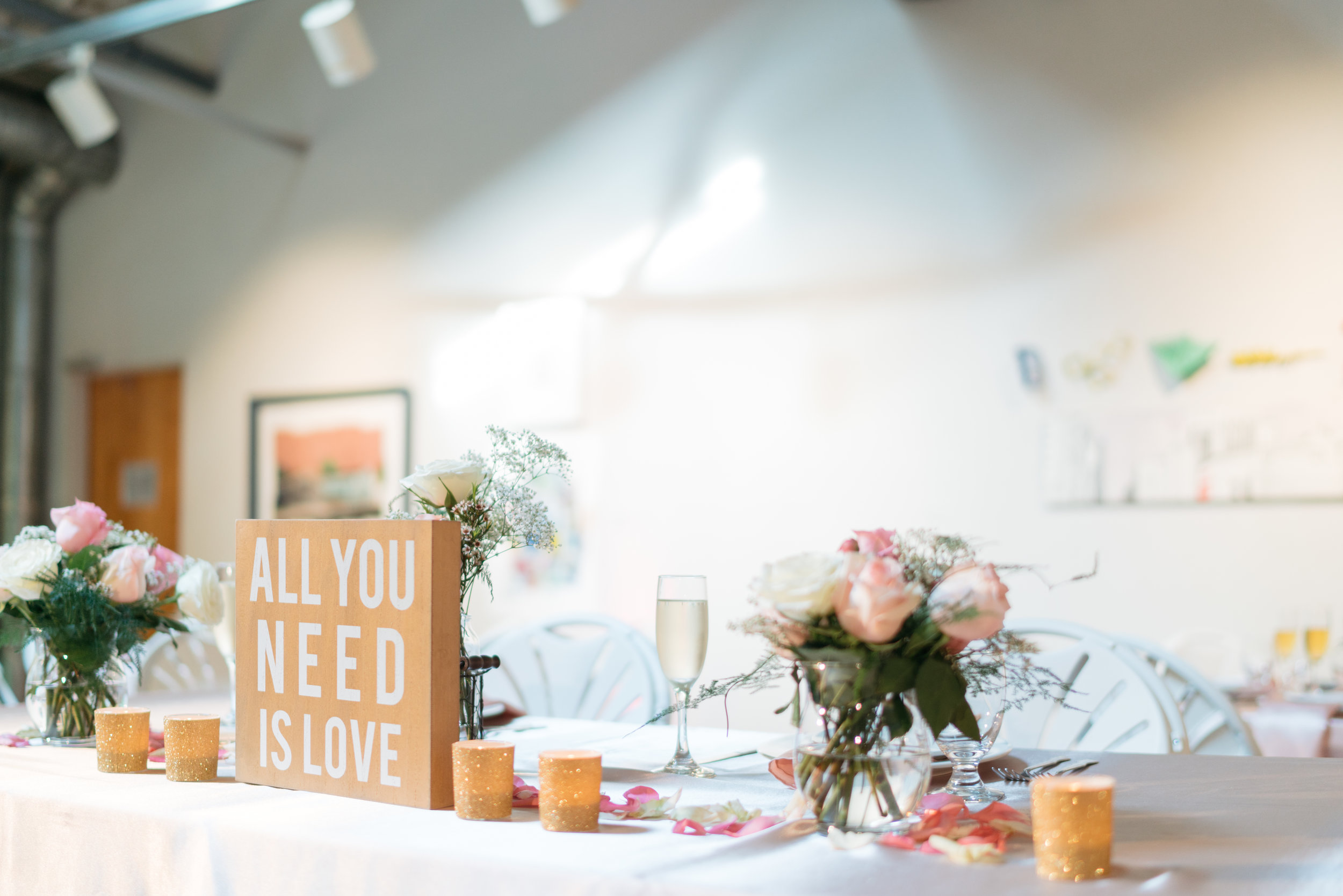 """Here is a side view of our table almost complete- the """"All you need is love,"""" sign was purchased from T.J. Maxx for the wedding and it was only $7.99 (score!)"""