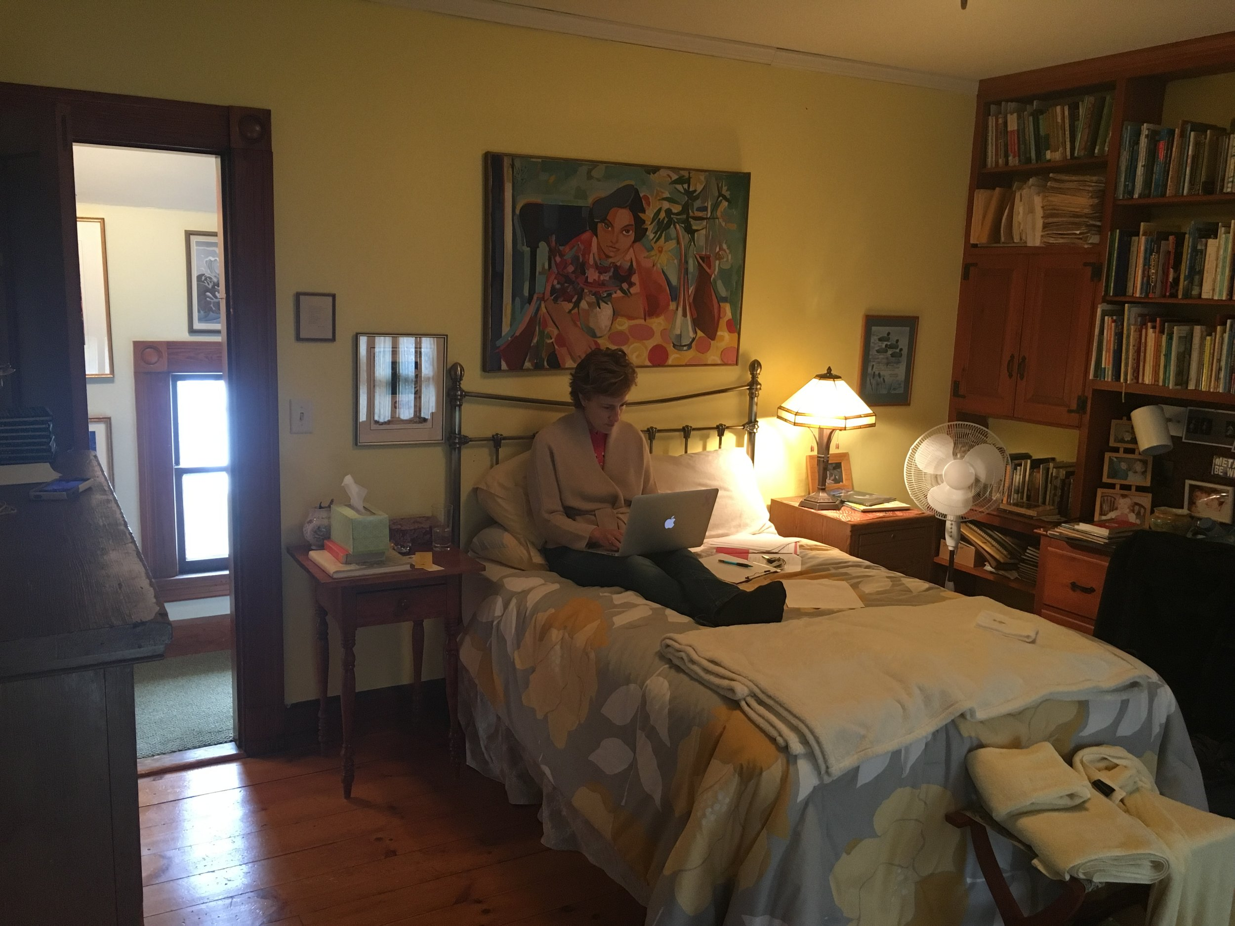 Revising a new manuscript in the Emily Dickinson Room at Phoenix Farm