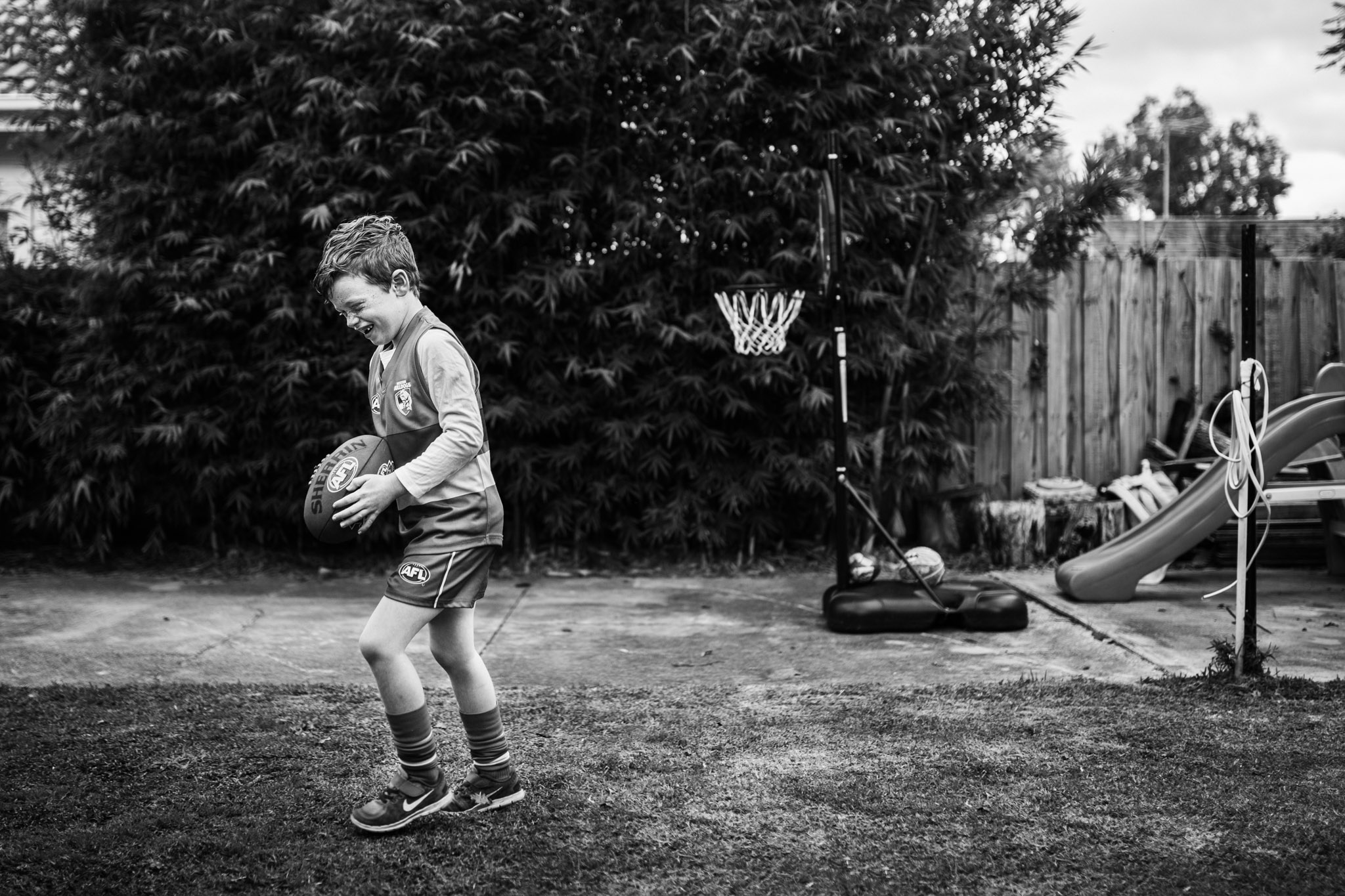 Boy smiling with football.