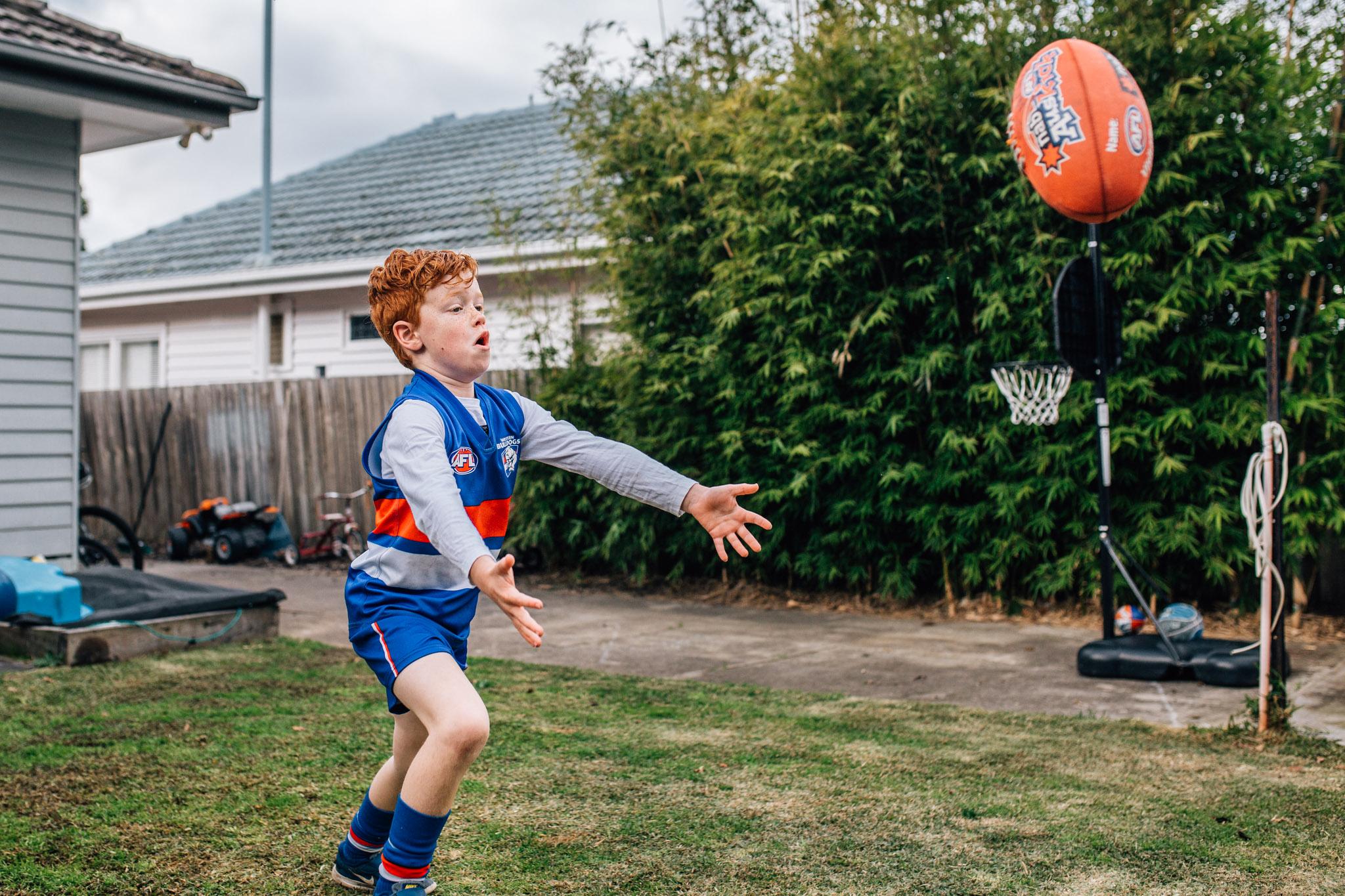 Boy catching football.