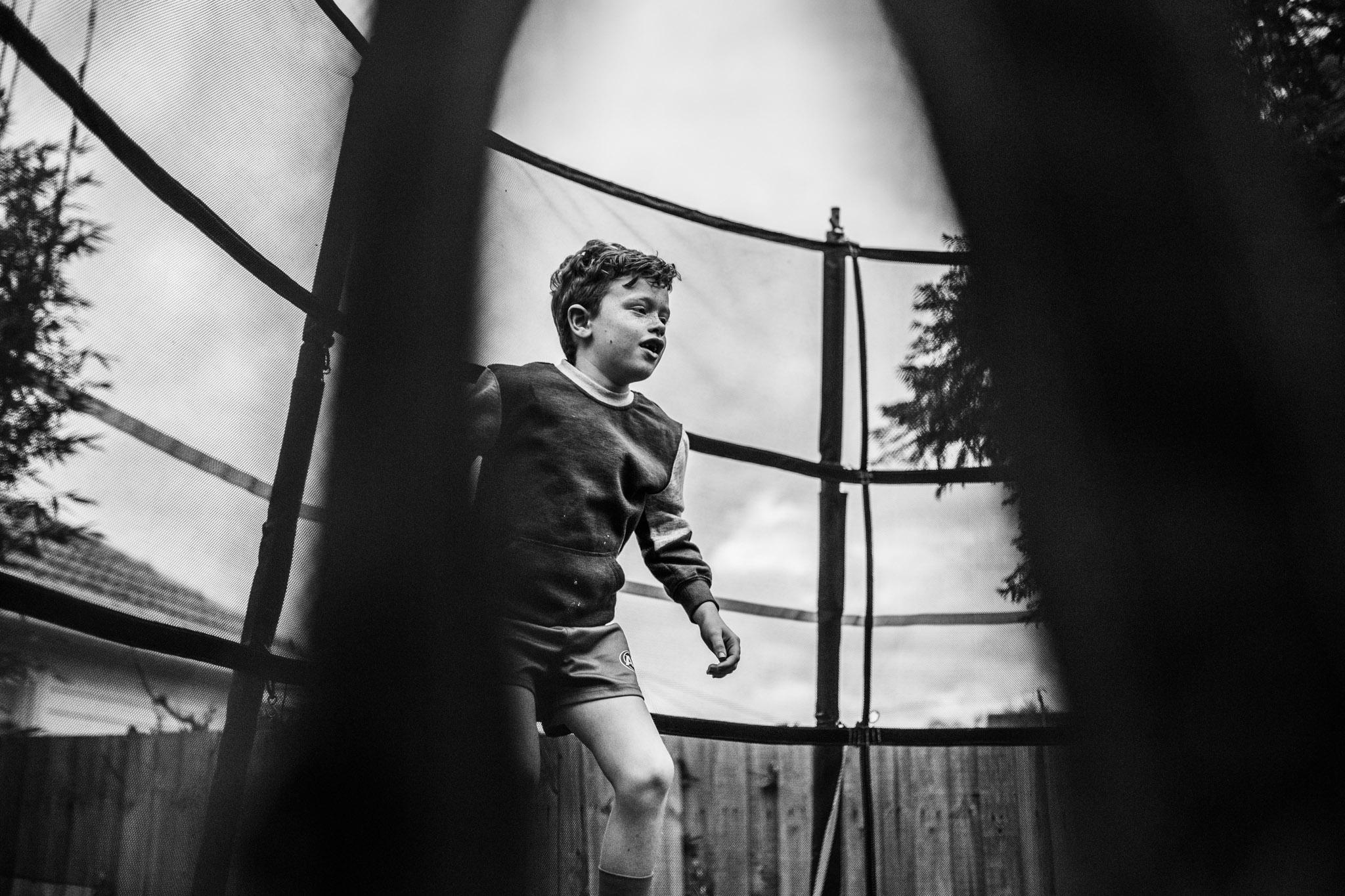 Boy on trampoline.